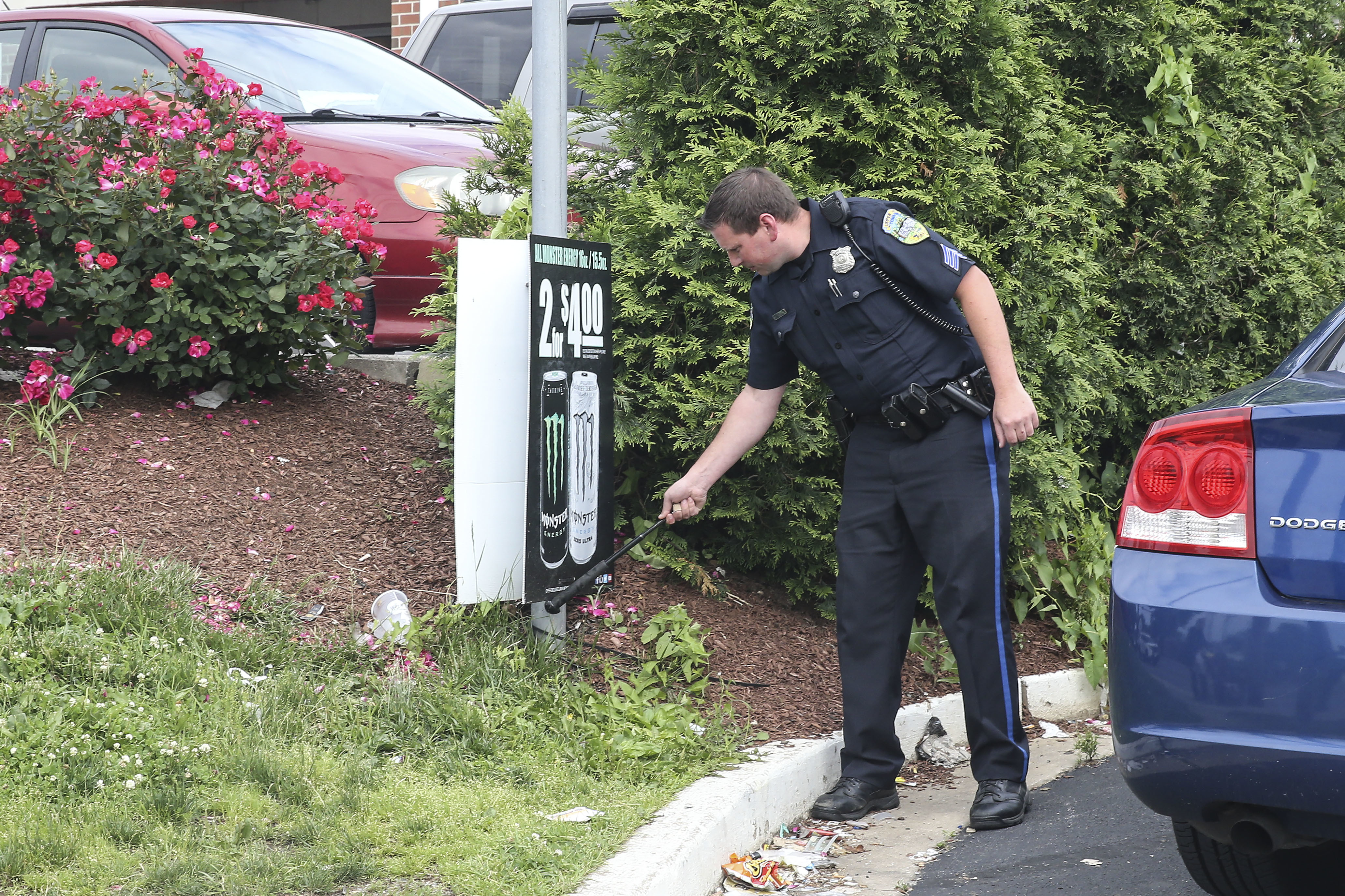 Upper Darby Police search for evidence near a gas station at State and Lansdowne avenue a few blocks from the school on. Monday June 4, 2018.