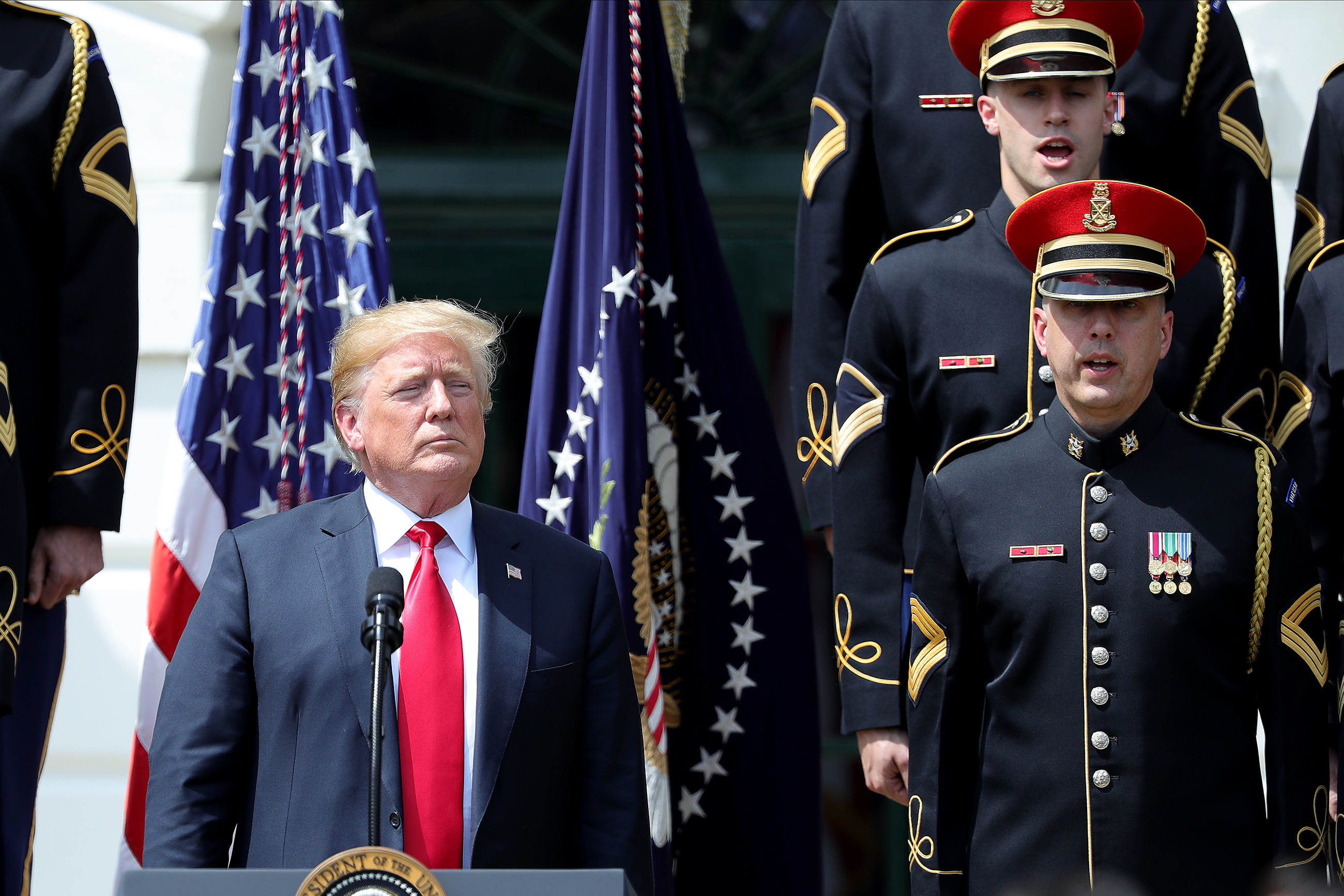 """President Donald Trump listens during the """"Celebration of America"""" event at the White House held in place of the ceremony honoring the Super Bowl champion Eagles."""