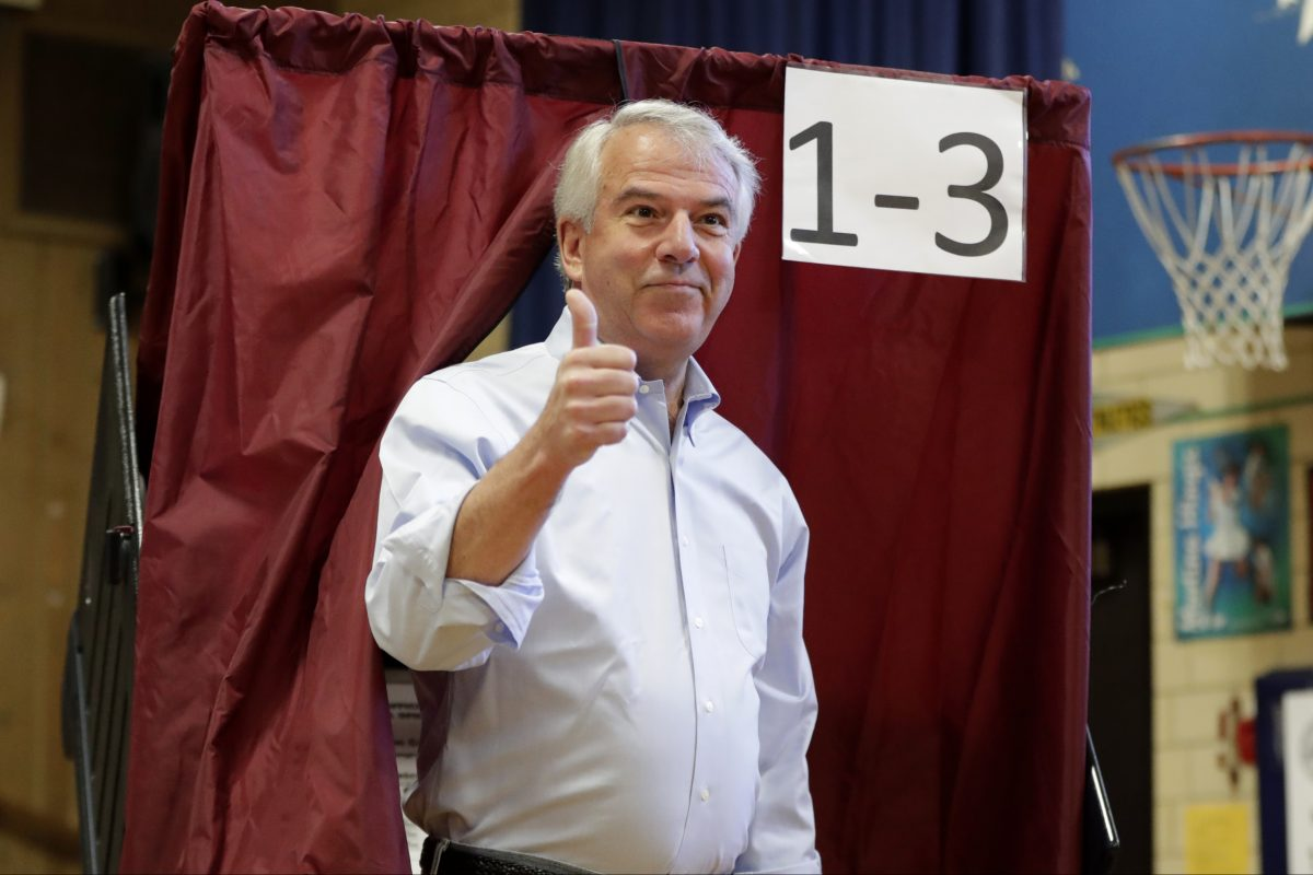 Bob Hugin, Republican candidate for U.S. Senate, casts his vote in his hometown of Summit Tuesday.