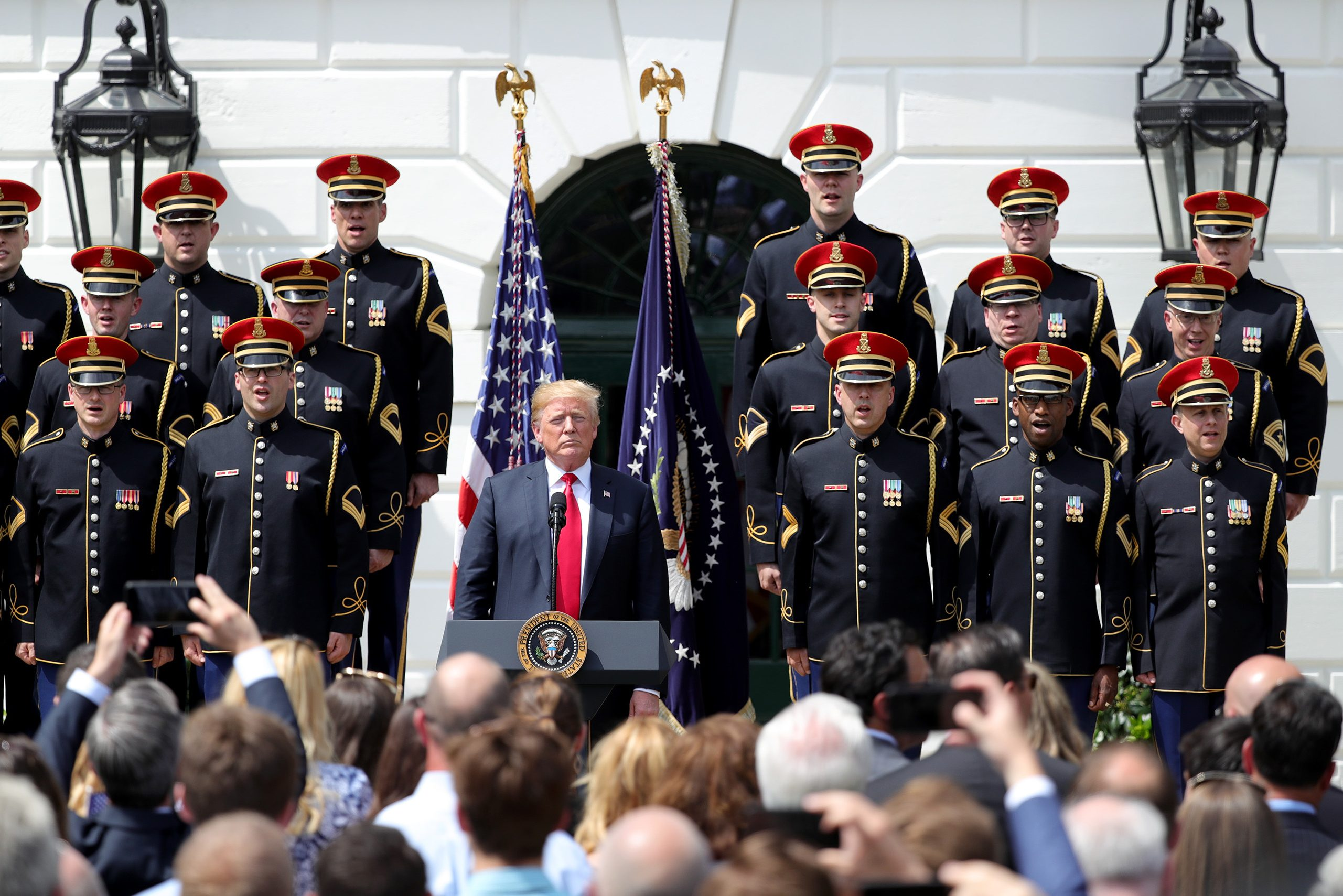 """President Trump listens during the singing of """"God Bless America"""" during Tuesday´s White House celebration sans the Eagles."""