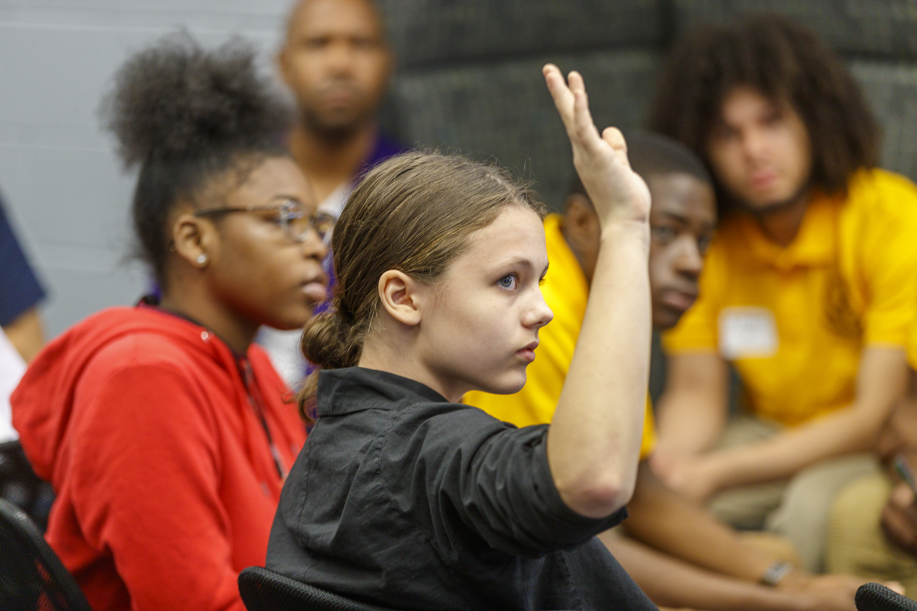 Sona Wink, 14, of Germantown Friends, raises a hand to be recognized durig a school gun violence forum at Parkway High School on Tuesday June 5, 2018.
