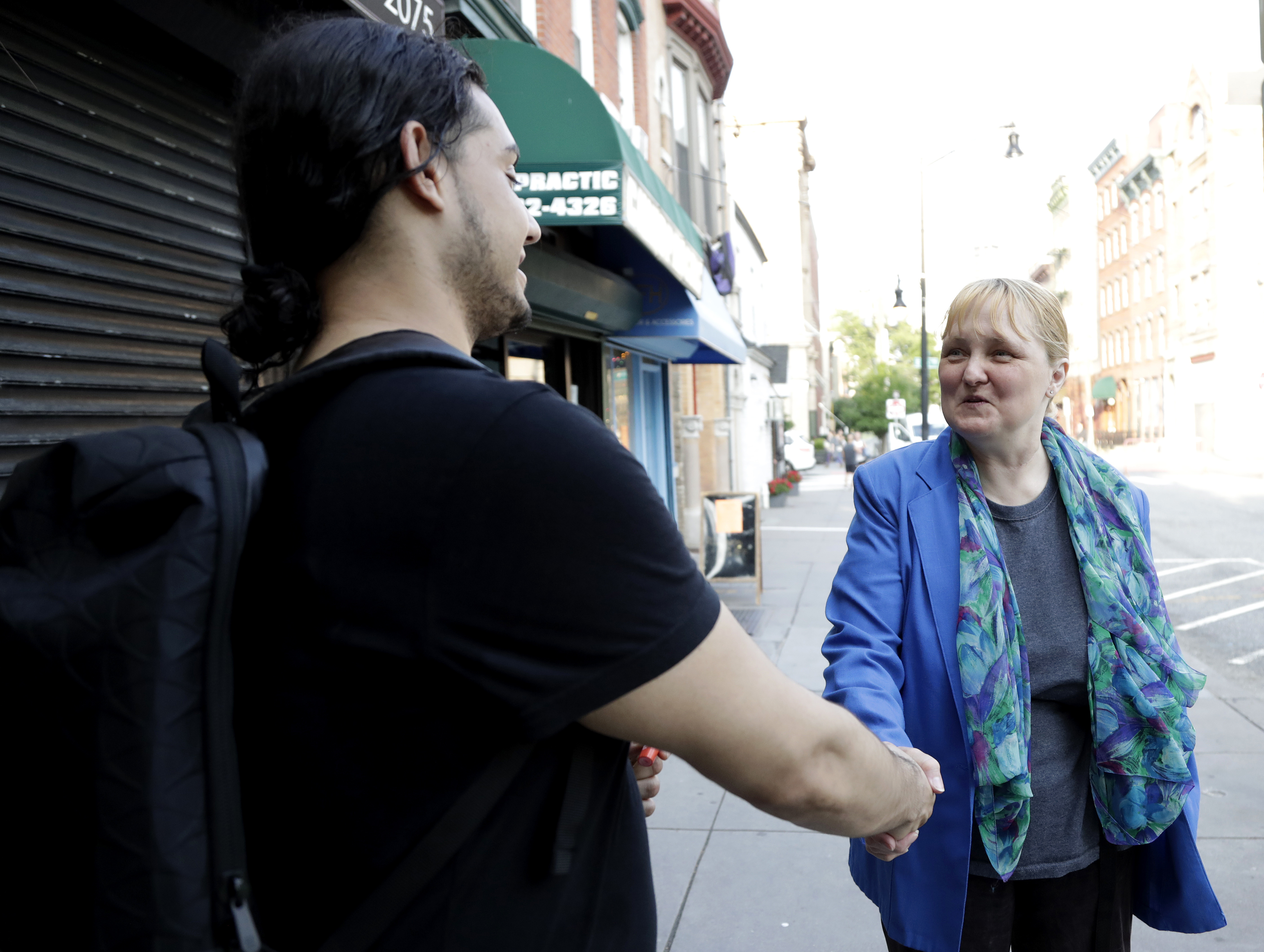 Lisa McCormick, a Democratic candidate running in New Jersey´s June primary for U.S. Senate, talks to Edgar Soto while campaigning in downtown Jersey City, N.J., Friday, June 1, 2018. This year´s race for a U.S. Senate seat from New Jersey won´t start officially until after the Democratic and Republican primaries on Tuesday, June 5.