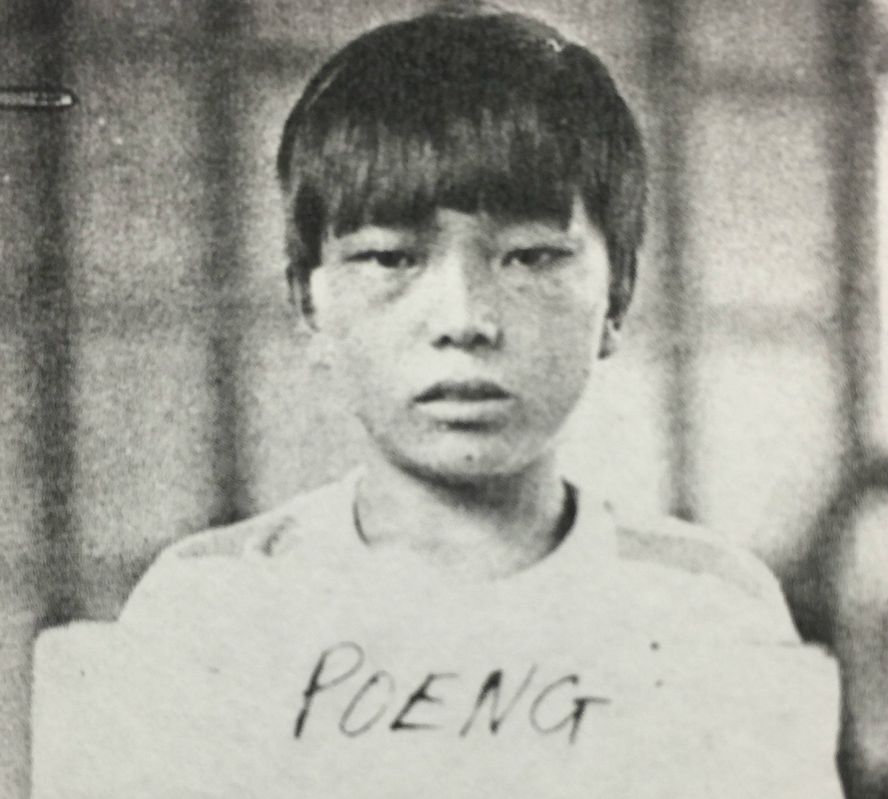 Mike Poeng´s refugee identification card, taken when he was 13 years old.