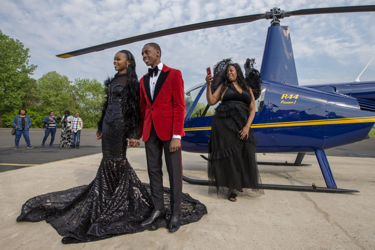Saudia Shuler, right, films her son, Nieme Brooker with his date Tiana Johnson in this James Bond-style prom send-off on May 12, 2018. They attended the Penn Wood prom later that evening. CHARLES FOX / Staff Photographer