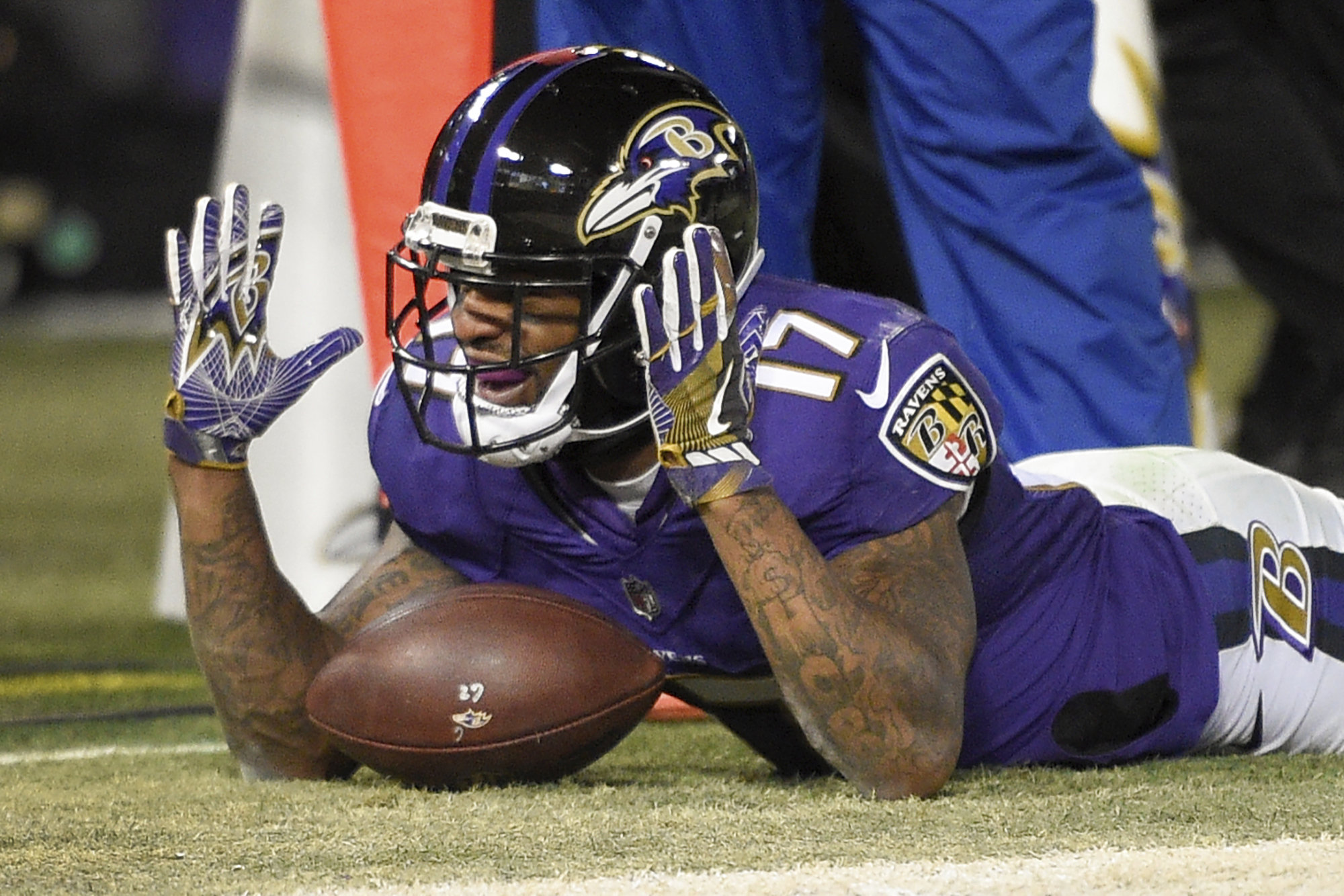 Mike Wallace, then with the Ravens, celebrating a touchdown against the Bengals in December.