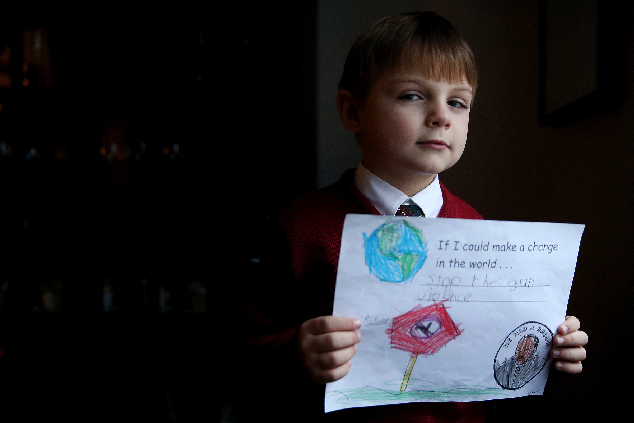 John Koger, 6, a first-grader at St. Mary Interparochial School, sits for a portrait with a drawing expressing his desire to end gun violence at his Philadelphia home on Friday, Jan. 12, 2018. TIM TAI / Staff Photographer