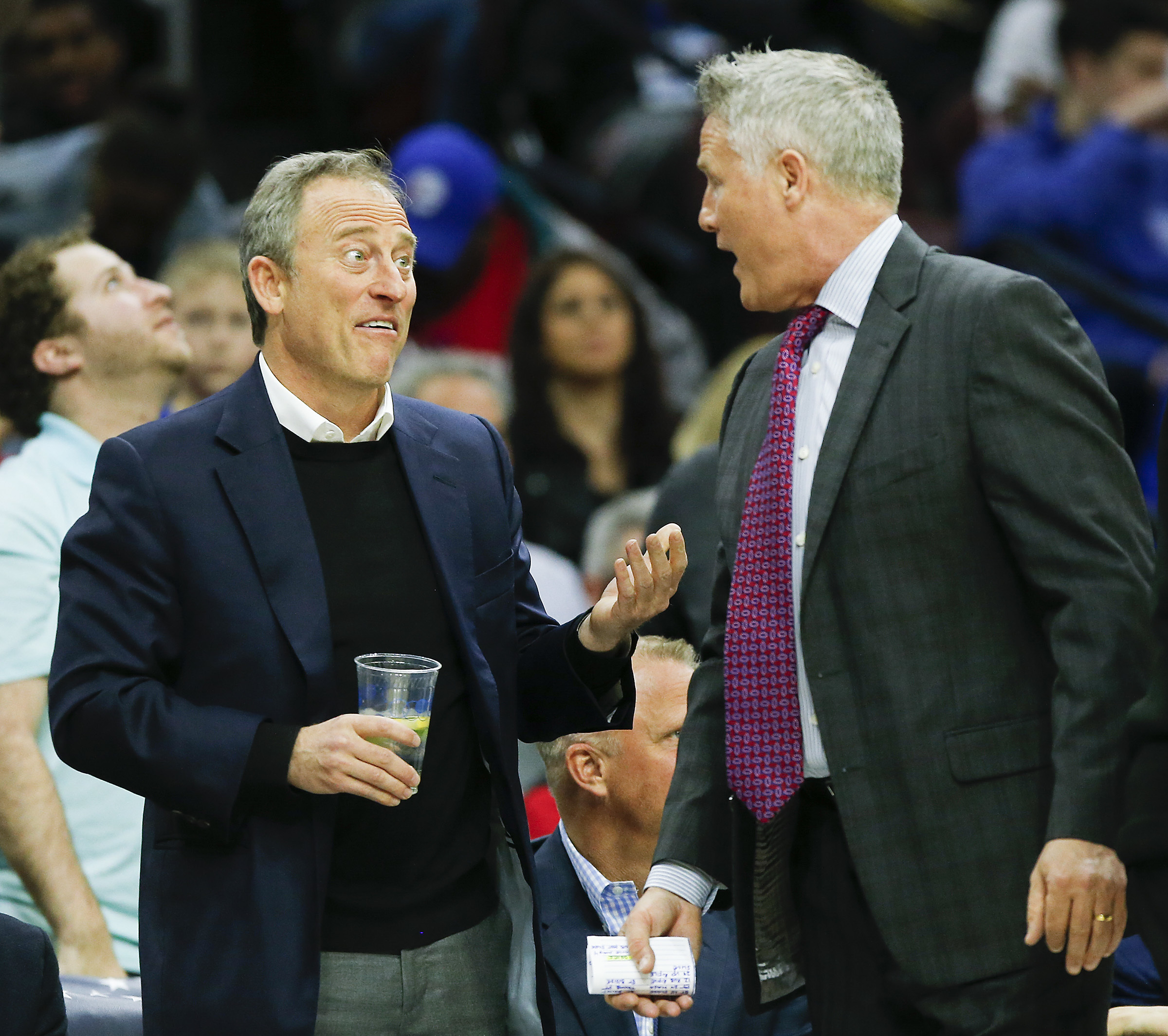 Sixers owner Josh Harris talking to coach Brett Brown (right) during an April game.