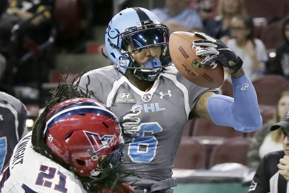 Valor defender Michael Knight proves ineffective as Soul wide receiver Darius Prince scores in the first half of the team's loss on Sunday at the Wells Fargo Center.