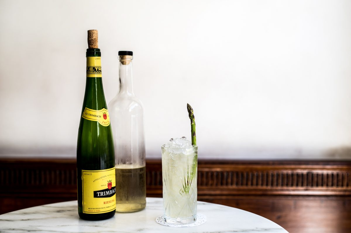The Alsatian Swizzle, a creation from Friday Saturday Sunday bartender Paul MacDonald, features an herb-infused vodka and a bright green asparagus garnish.