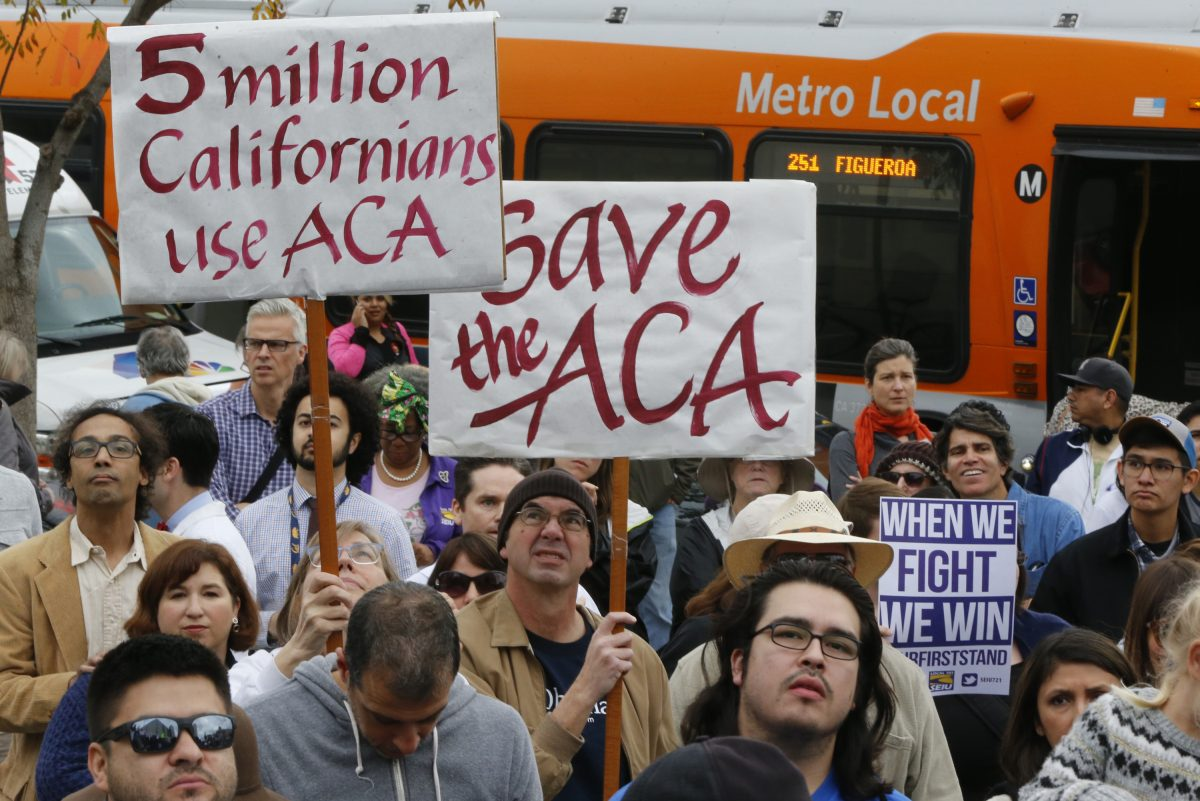 Californians join health care workers at a rally to save the Affordable Care Act across the country outside LAC+USC Medical Center in Los Angeles Sunday, Jan. 15, 2017.