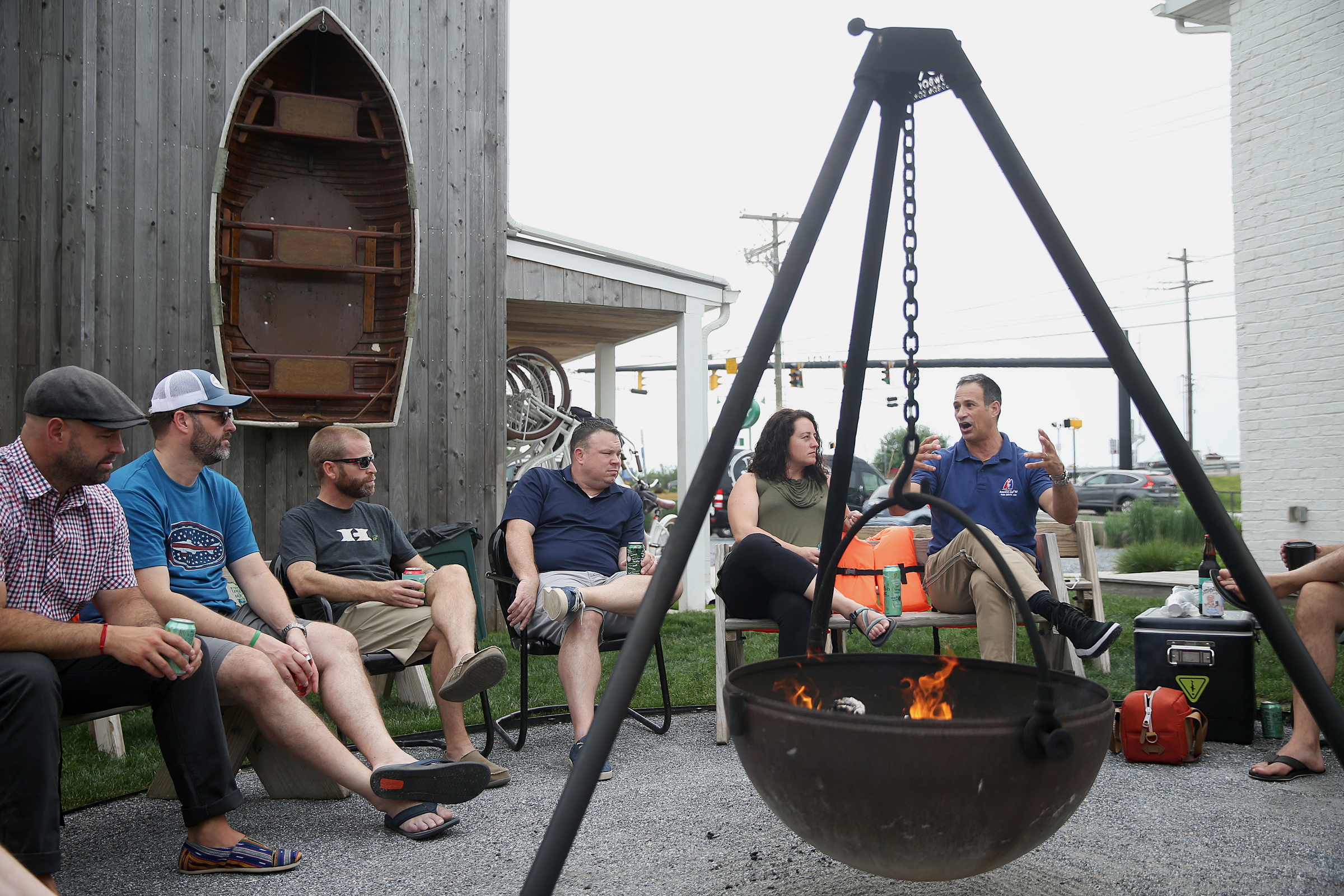 "Dogfish Head Brewery founder Sam Calagione, right, talks with guests at the Dogfish Inn in Lewes, Del., during one of his occasional ""fireside chats"" on Saturday, June 2, 2018."