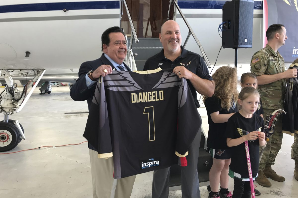 Inspira Health Network CEO John DiAngelo (left) and Wings head coach/general manager Paul Day (right) pose during the unveiling of the Philadelphia Wings home jerseys on Tuesday.