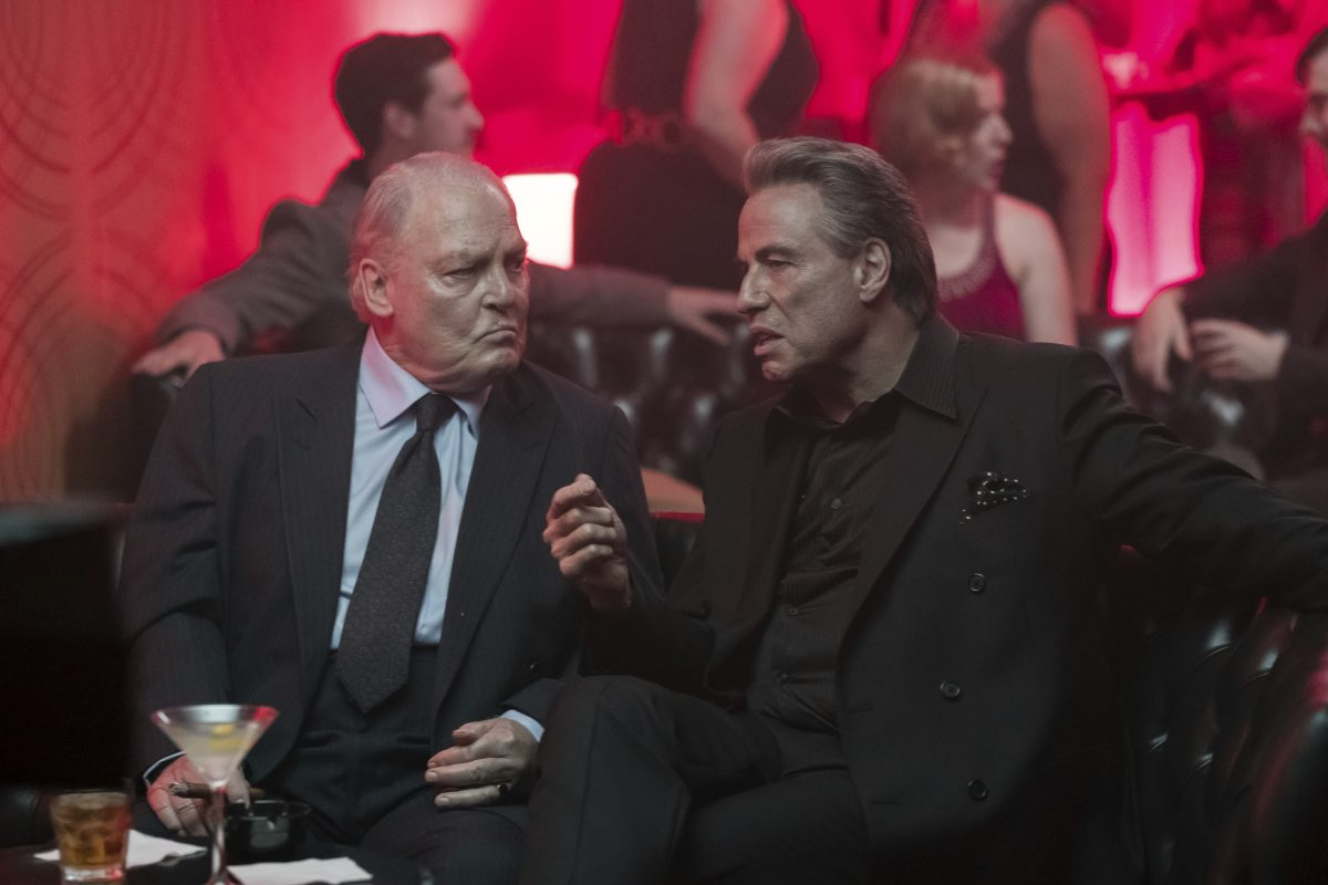 "Stacy Keach, left, and John Travolta in a scene from ""Gotti.'"