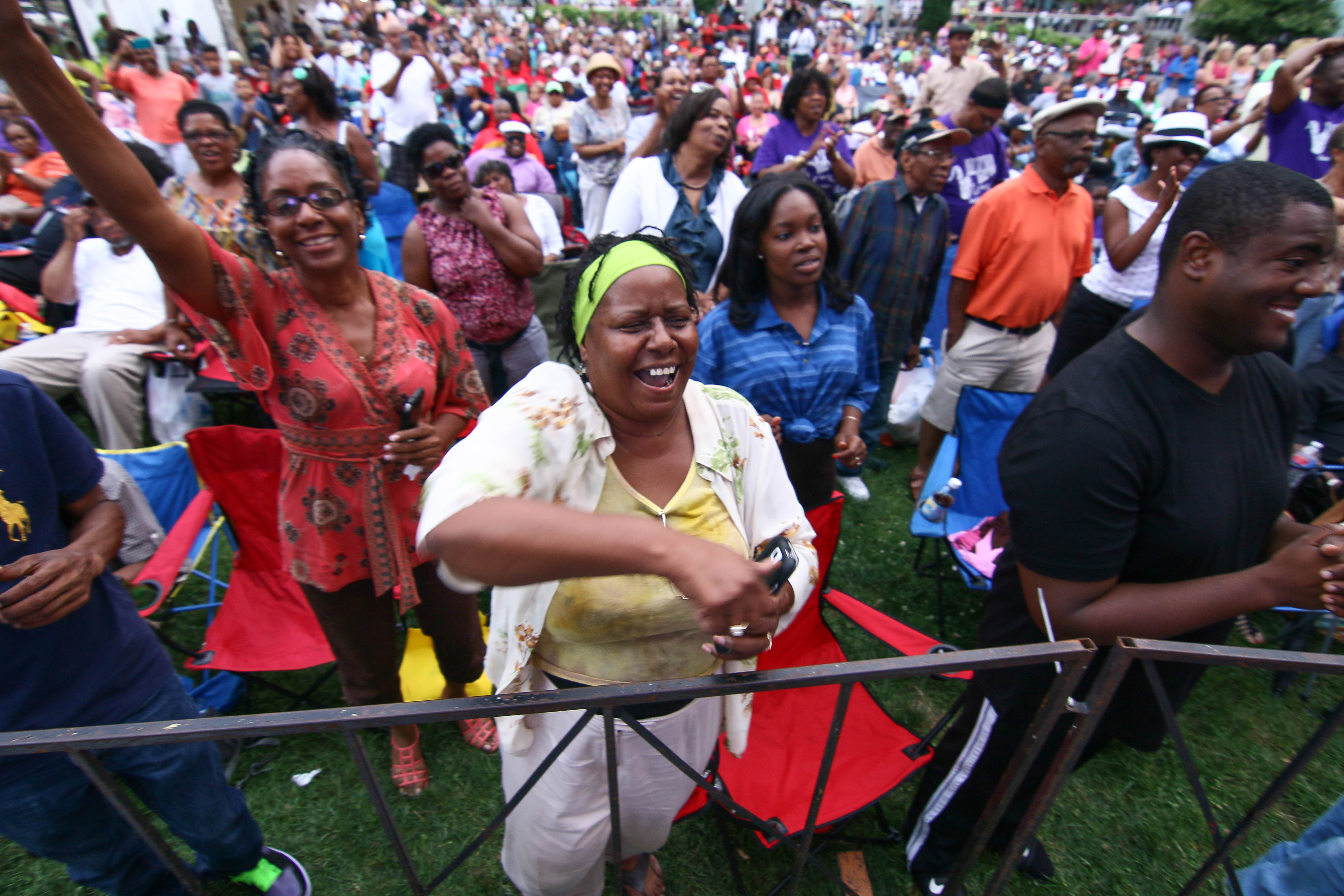 The crowd cheers during Brian Culbertson performance on the last day of the 26th annual duPont Clifford Brown Jazz Festival Saturday, June 21, 2014, at Rodney Square Park in Wilmington, Del.
