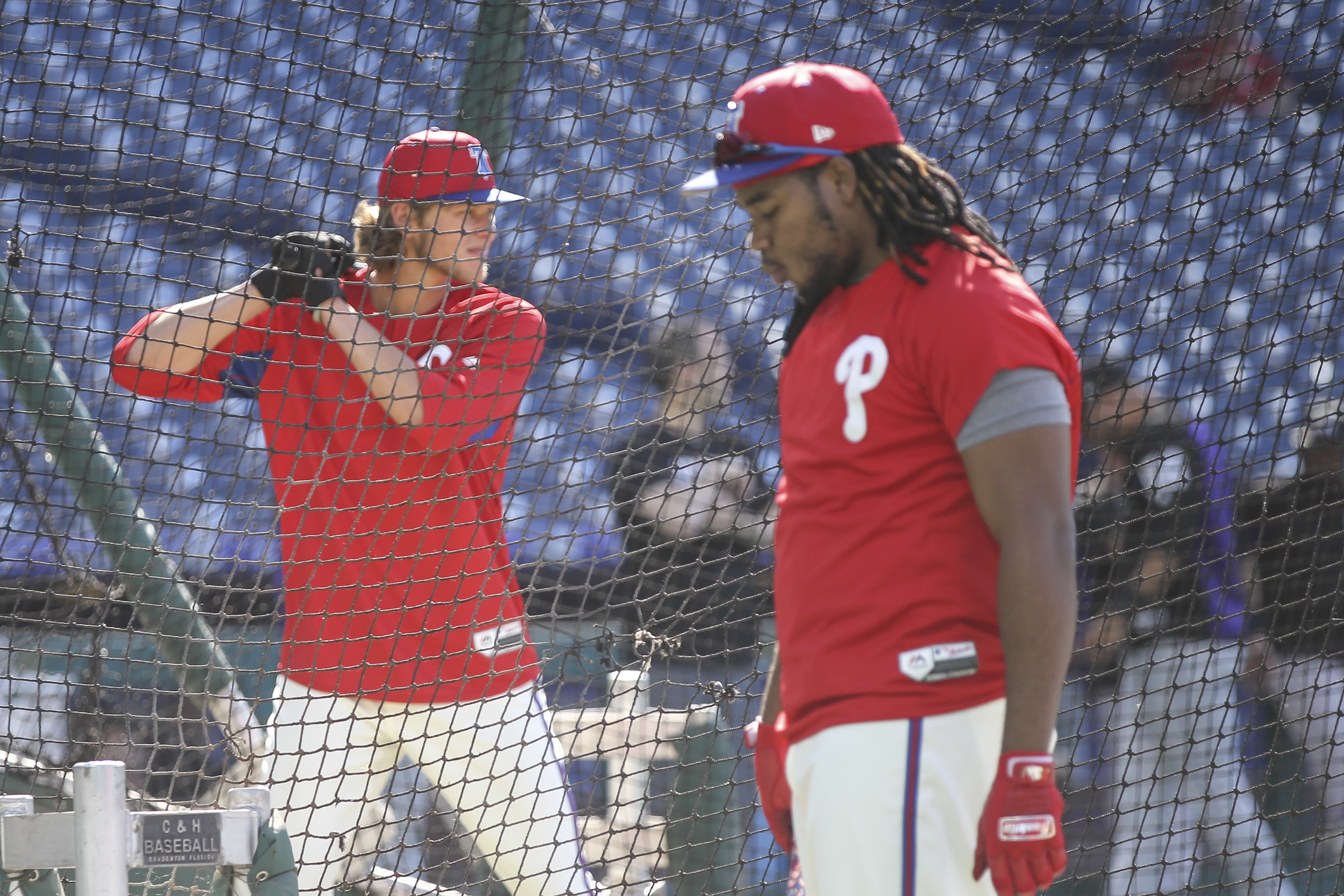 Phillies Maikel Franco waits while 2018 first-round pick Alec Bohm takes batting practice.