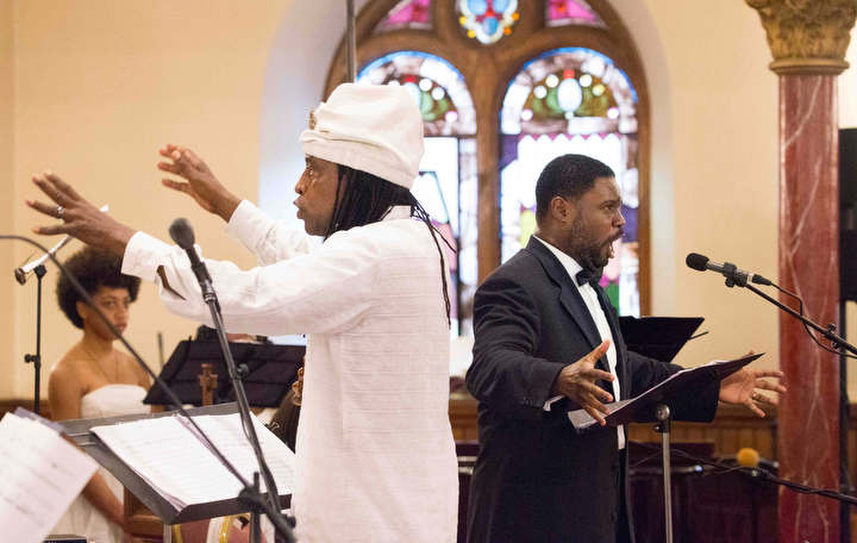 Philadelphia Orchestra Music Alive Composer-in-Residence Hannibal Lokumbe, left, and Rodrick Dixon as Tenor, right, performing the world premiere of Crucifixion Resurrection: Nine Souls a Traveling, at the Mother Bethel African Methodist Episcopal Church, Saturday, June 17, 2017.