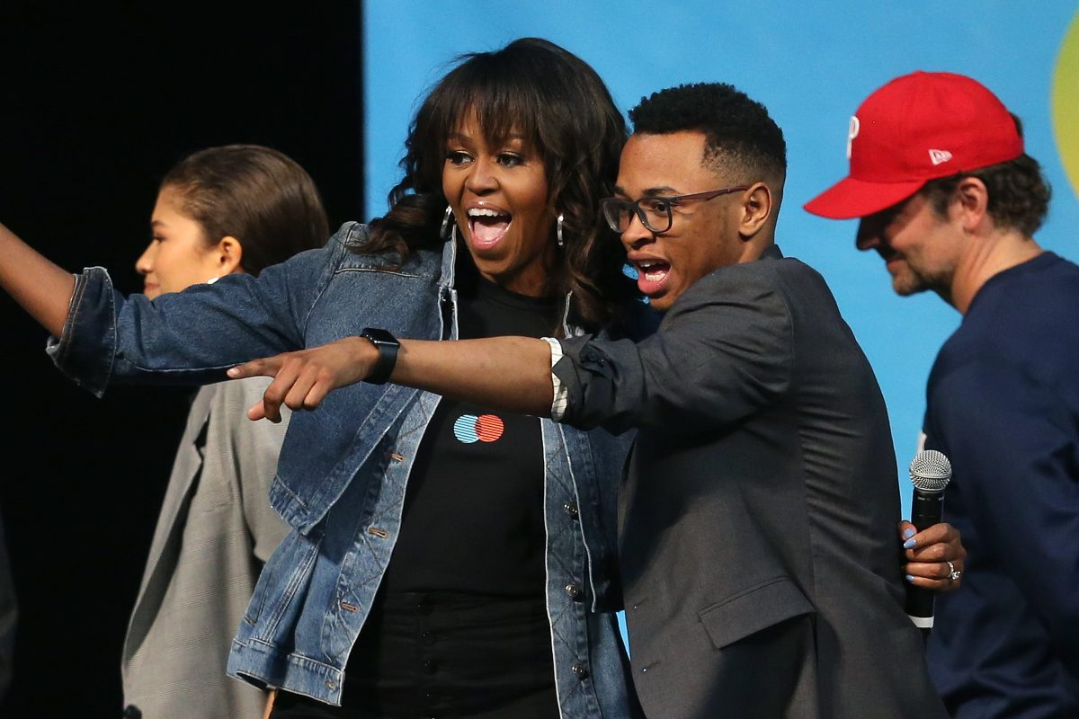 Tamir Harper, onstage with former First Lady Michelle Obama at National College Signing Day.
