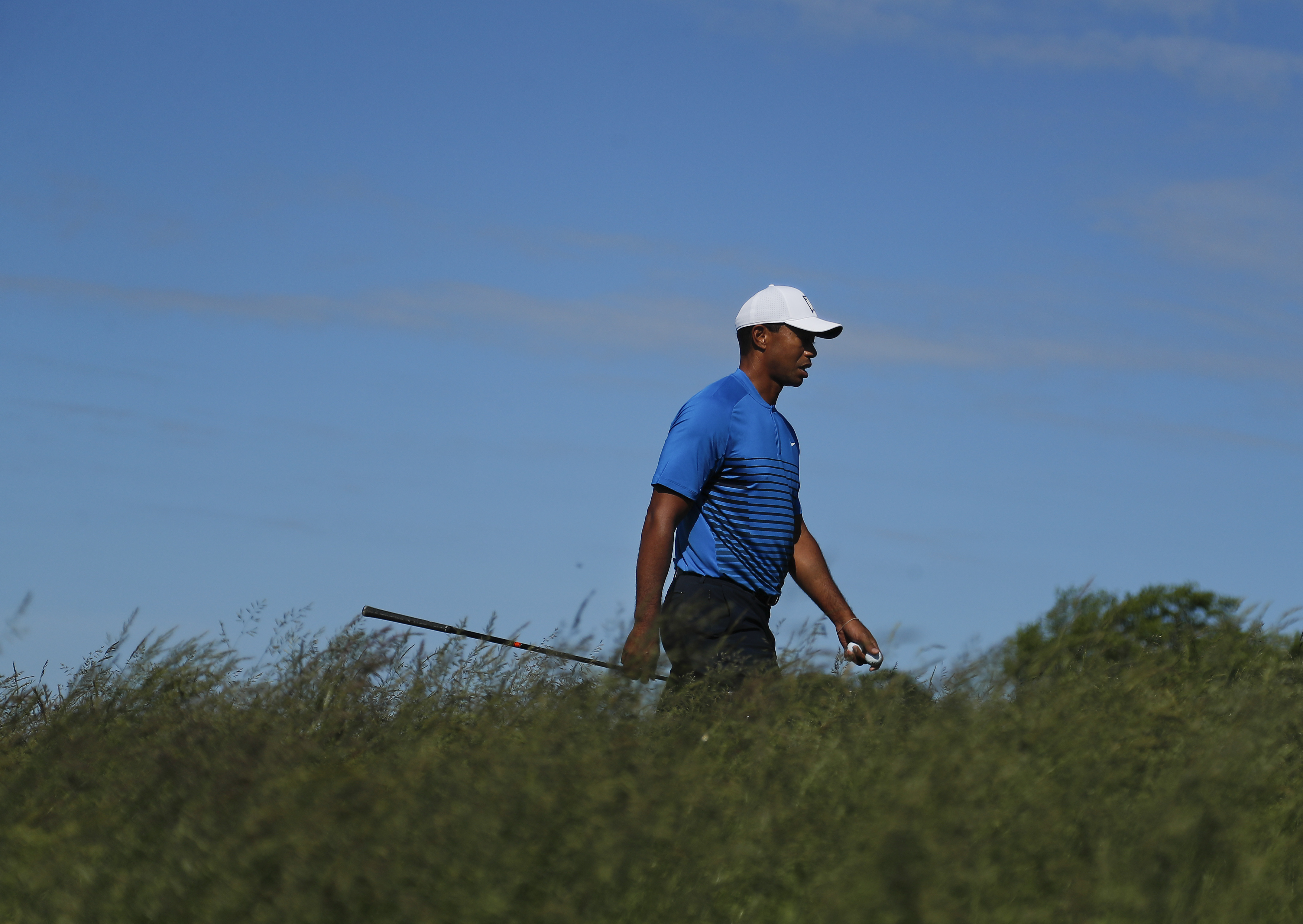 Tiger Woods walks up to the sixth tee during a practice round for the U.S. Open Golf Championship on Tuesday.