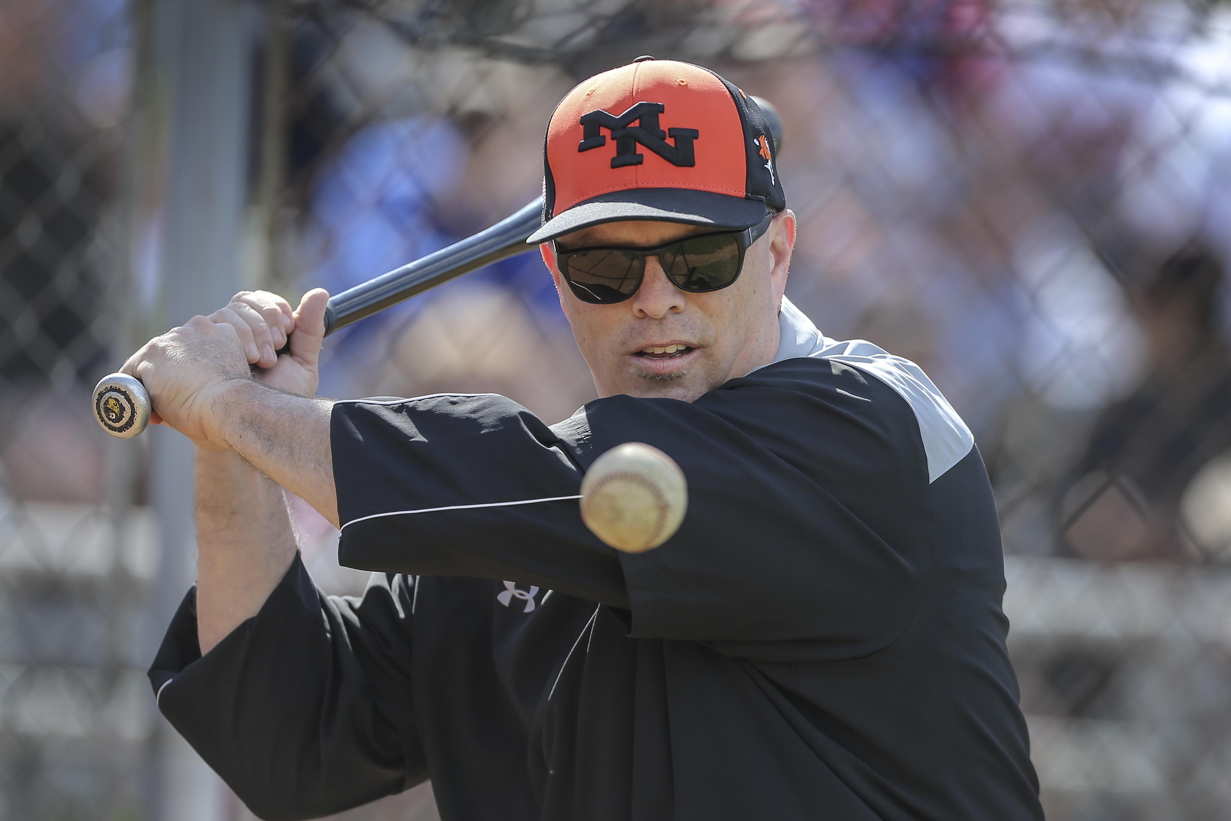 Marple Newtown coach Mark Jordan hits a few during batting practice.