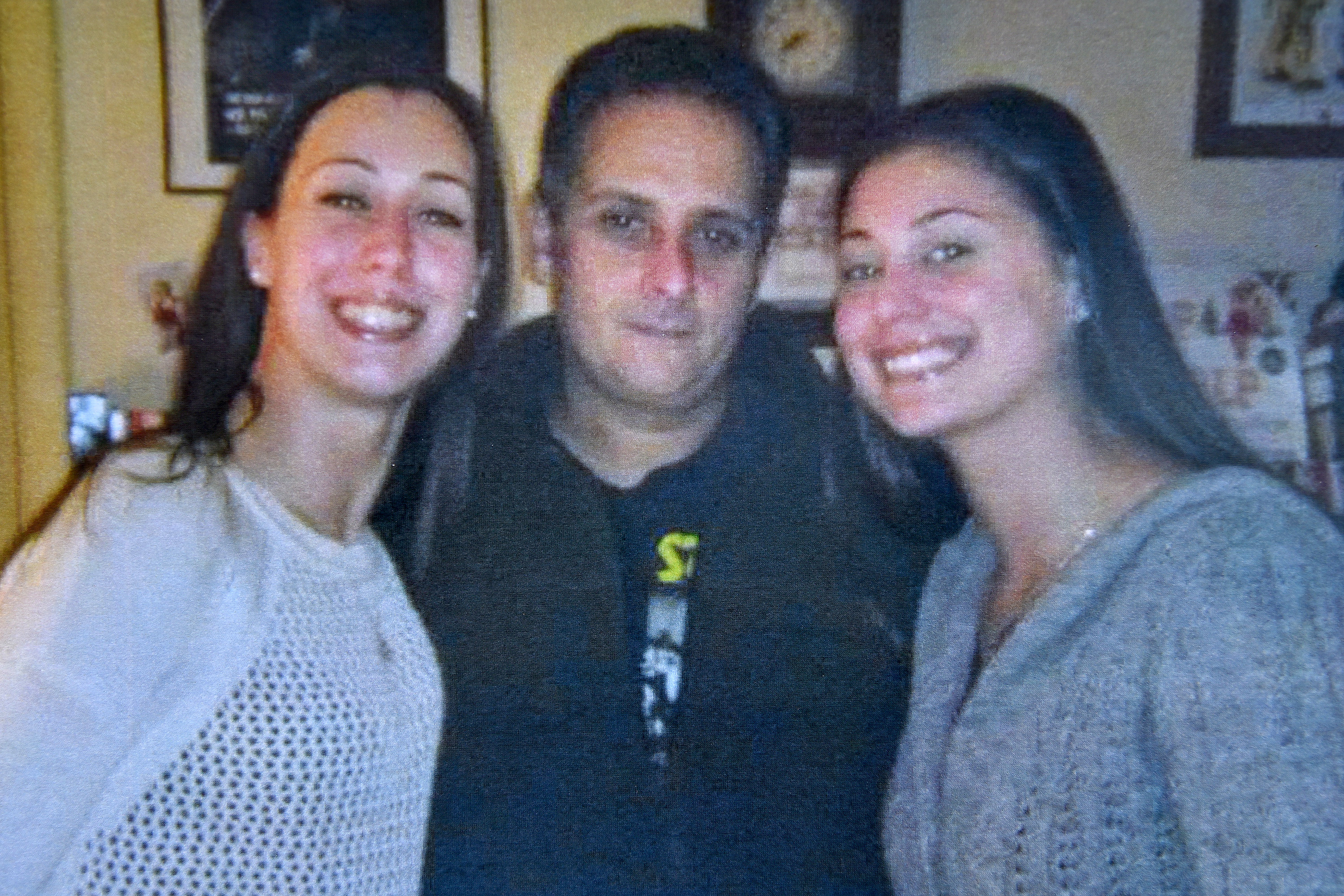 Danny Dimitri, a Northeast Philadelphia cook was killed in January by an off duty police officer racing a fellow off duty officer down Cottman Avenue on their way home from the gym. He is seen in family photo from Christmas 2015, with his nieces Stephanie Prosinski, 30 (left) and Brittany Prosinski, 31(right).