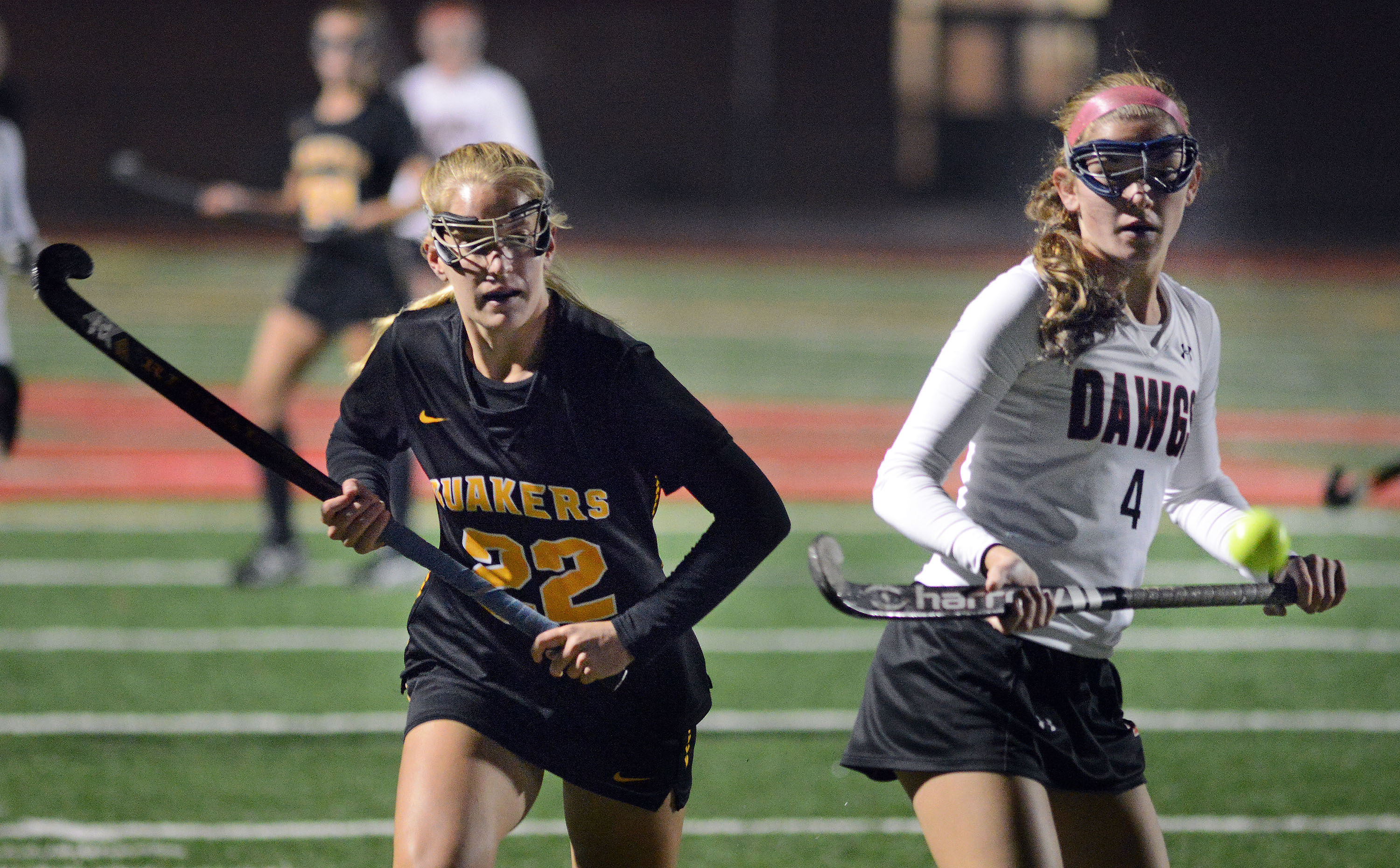 Haddonfield´s Jaimie McCormick (right) chasing a loose ball with Moorestown´s Julia Darmo during a field hockey game in November.