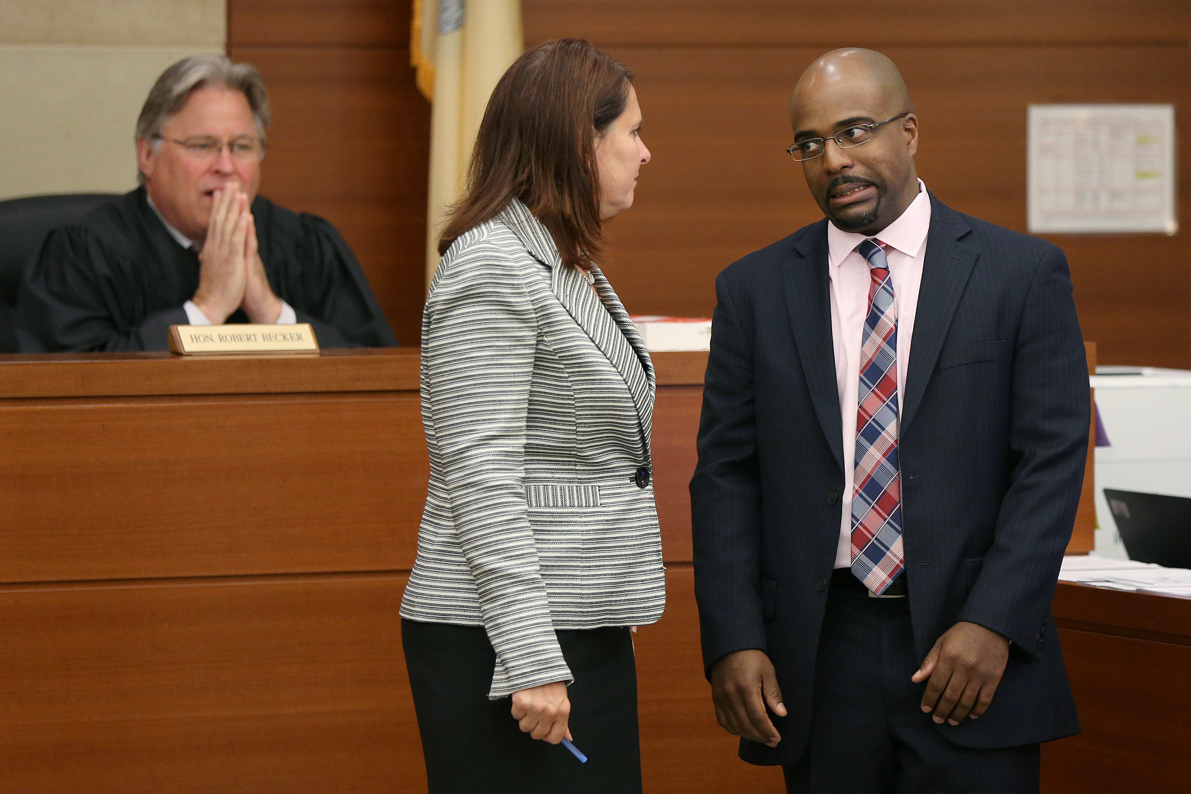 Defense attorney Julius Hughes, right, talks with assistant prosecutor Dianna Reed-Rolando, center, in Judge Robert Becker´s courtroom before a Gloucester County Superior Court detention hearing in Woodbury, N.J., on Thursday, June 14, 2018. Barnes is accused of shoplifting from a Marshalls store in Deptford on Saturday, an incident that ended with a police officer fatally shooting LaShanda Anderson as the two allegedly attempted to flee in a car.