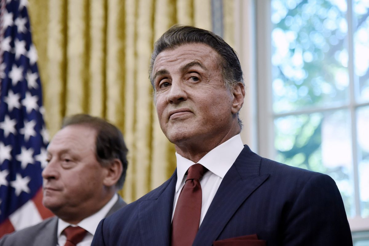 Actor Sylvester Stallone looks on during a signing ceremony to grant of clemency for former heavyweight champion Jack Johnson in the Oval Office of the White House on May 24, 2018, in Washington, D.C.