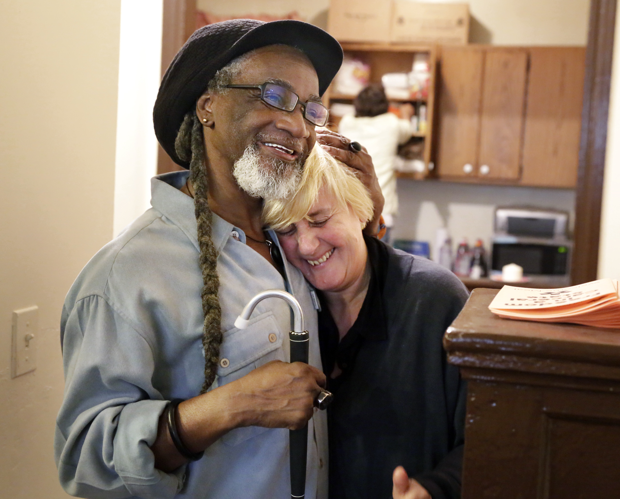 "William Goldsby, chairman and founder of Reconstruction Inc. hugs Dutch artist Jeanne van Heeswijk after the community-based ""Welcome Meal"" for those participating in the Nicetown/Tioga ""Reconstruction"" project. in Phila. on May 13, 2017. ( ELIZABETH ROBERTSON / Staff Photographer ) Philadelphia Assembled, a sprawling, maddeningly complex project unfolding over the summer, will light underpasses in Nicetown/Tioga, engage exoffenders, hold community feasts and processionals and gather stories. That´s just a tiny part of its ambitious mission"