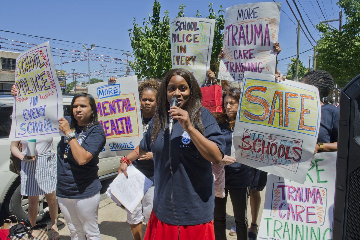 Robin Cooper, head of CASA (Commonwealth Association of School Administrators) speaks to attendees outside the Girard Academic Music Program (GAMP) school in South Philadelphia  during a rally on violence against teachers and adminstrators in Philadelphia public schools.