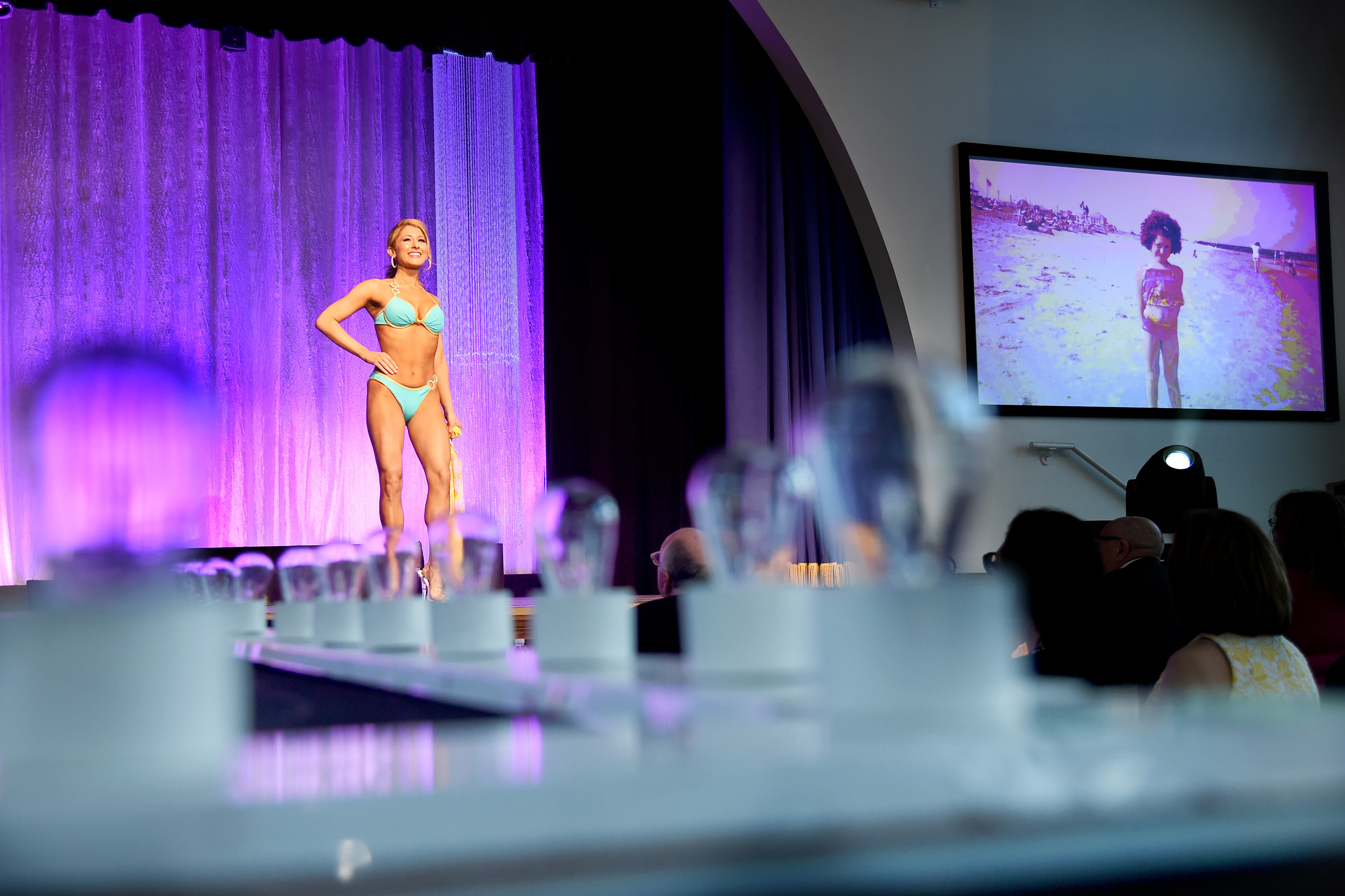 A photo of her as a youngster in a swimsuit is shown as Miss Avalon, Lauren Staub, 24, of Avon competes in the swimsuit competition on the first day of preliminaries of the Miss New Jersey pageant at Music Pier in Ocean City June 14, 2018. The state pageant - unlike Miss America - includes the swimsuit and evening gown competitions.