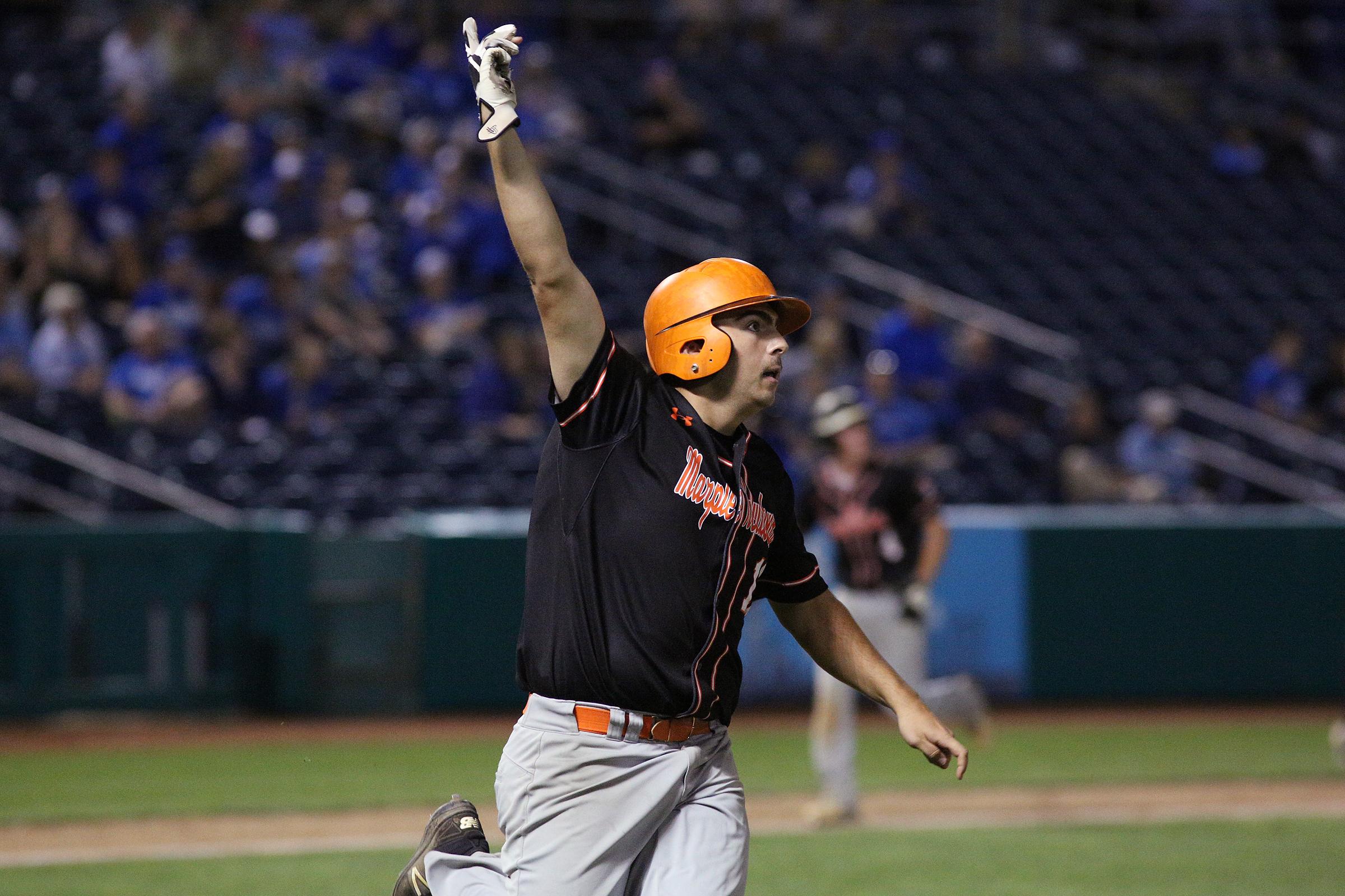 Marple Newtown´s Luke Zimmerman celebrates his walkoff, state-championship hit.