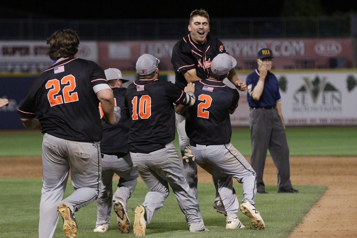 Marple Newtown´s Luke Zimmerman (17) is mobbed by teammates after his walkoff single in the 10th inning.
