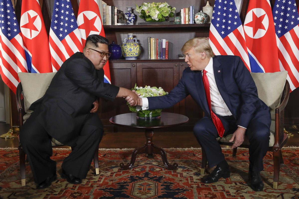 In this Tuesday, June 12, 2018, file photo, North Korea leader Kim Jong Un, left, and U.S. President Donald Trump shake hands during their first meeting at the Capella resort on Sentosa Island in Singapore.