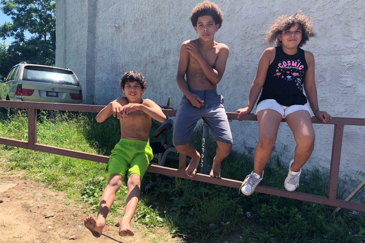 Siblings Paul Miller, 12, Ania Crawley, 9 and Jermiah Morales, 8, near 11th and Wyoming discuss their summer plans.