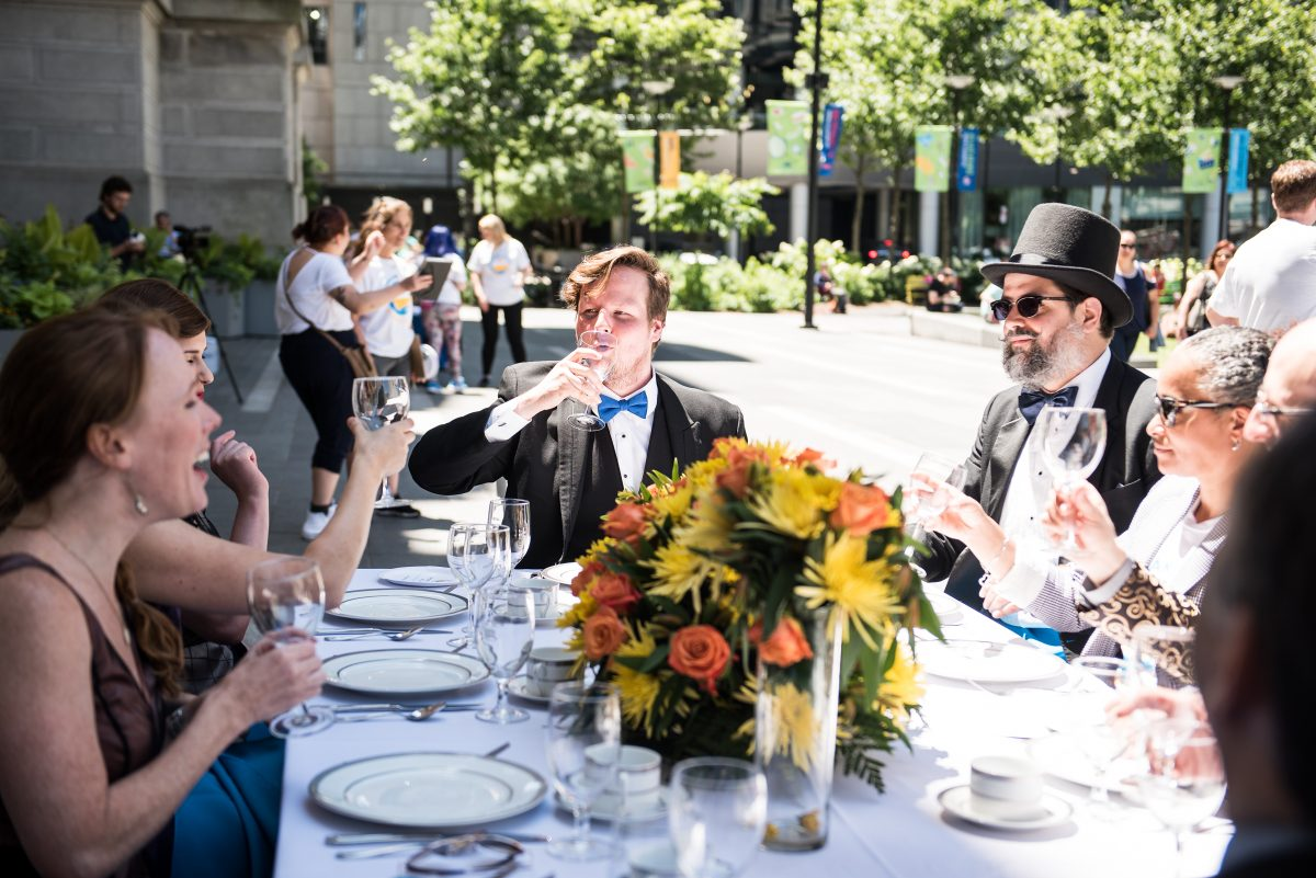 "Actors sipped from empty wine glasses during the Covenant House´s ""Invisible Lunch"" on Friday, June 15 at Dilworth Park."