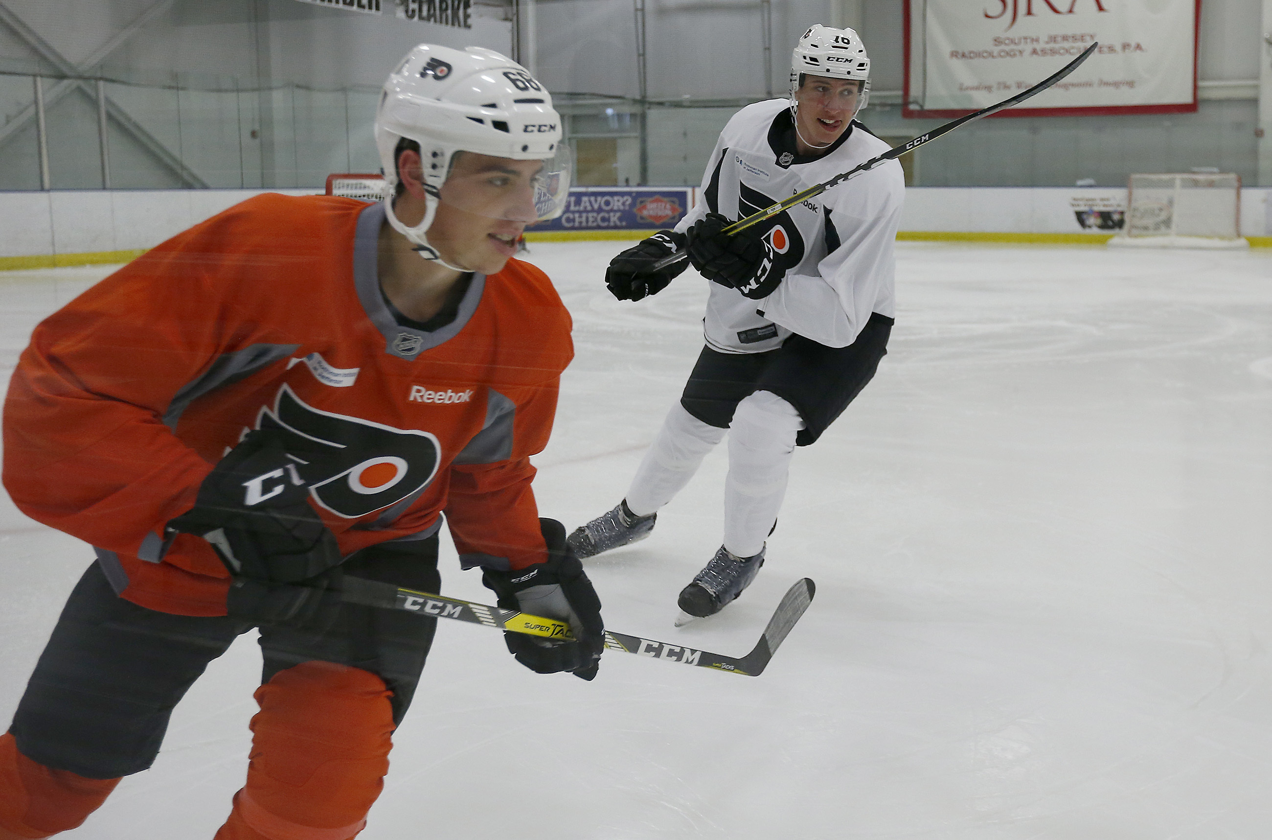Morgan Frost (left) and Isaac Ratcliffe at the Flyers´ development camp last year.