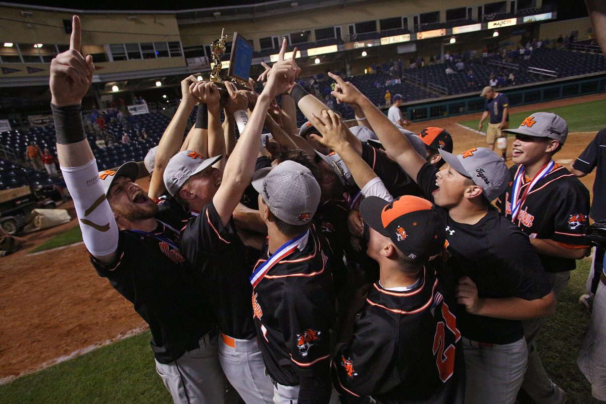 The Marple Newtown players and coaches celebrate after winning the state championship.