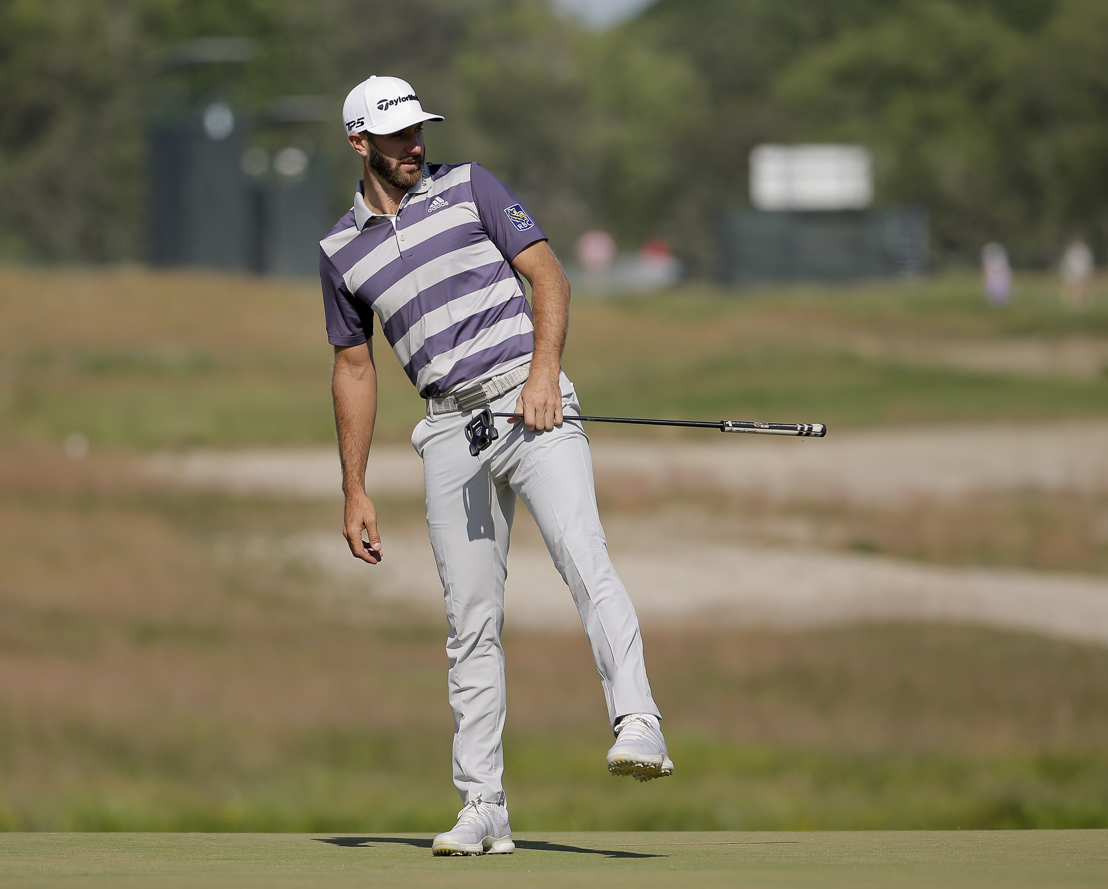 Dustin Johnson reacts to missing a putt on the sixth green during the third round of the U.S. Open on Saturday.