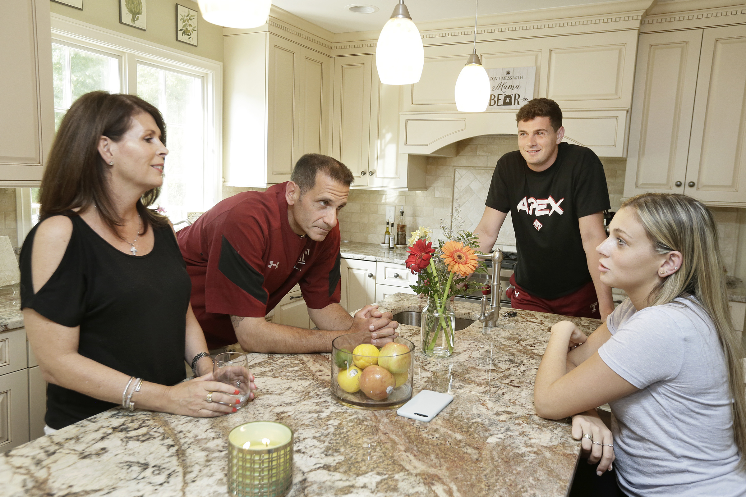 (L-R) Rose and Robert Nutile with son, Temple quarterback Frank Nutile, and daughter Gianna Nutile in the kitchen of their Wayne, NJ home on June 8, 2018.