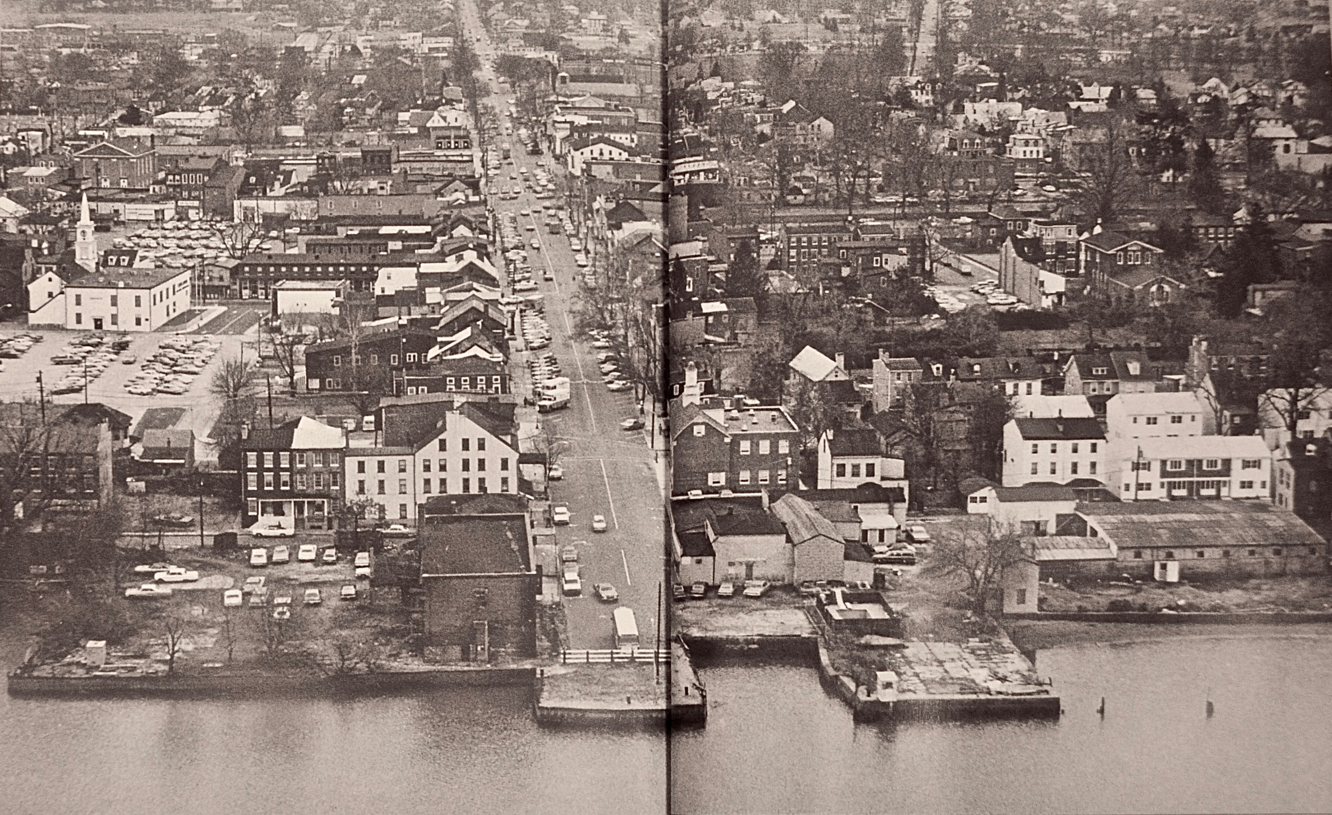 Burlington City waterfront in the 70´s, as shown from an aerial view. It depicts the rowhouses and factories that once lined the Delaware River. Now there is a promenade and grassy park.