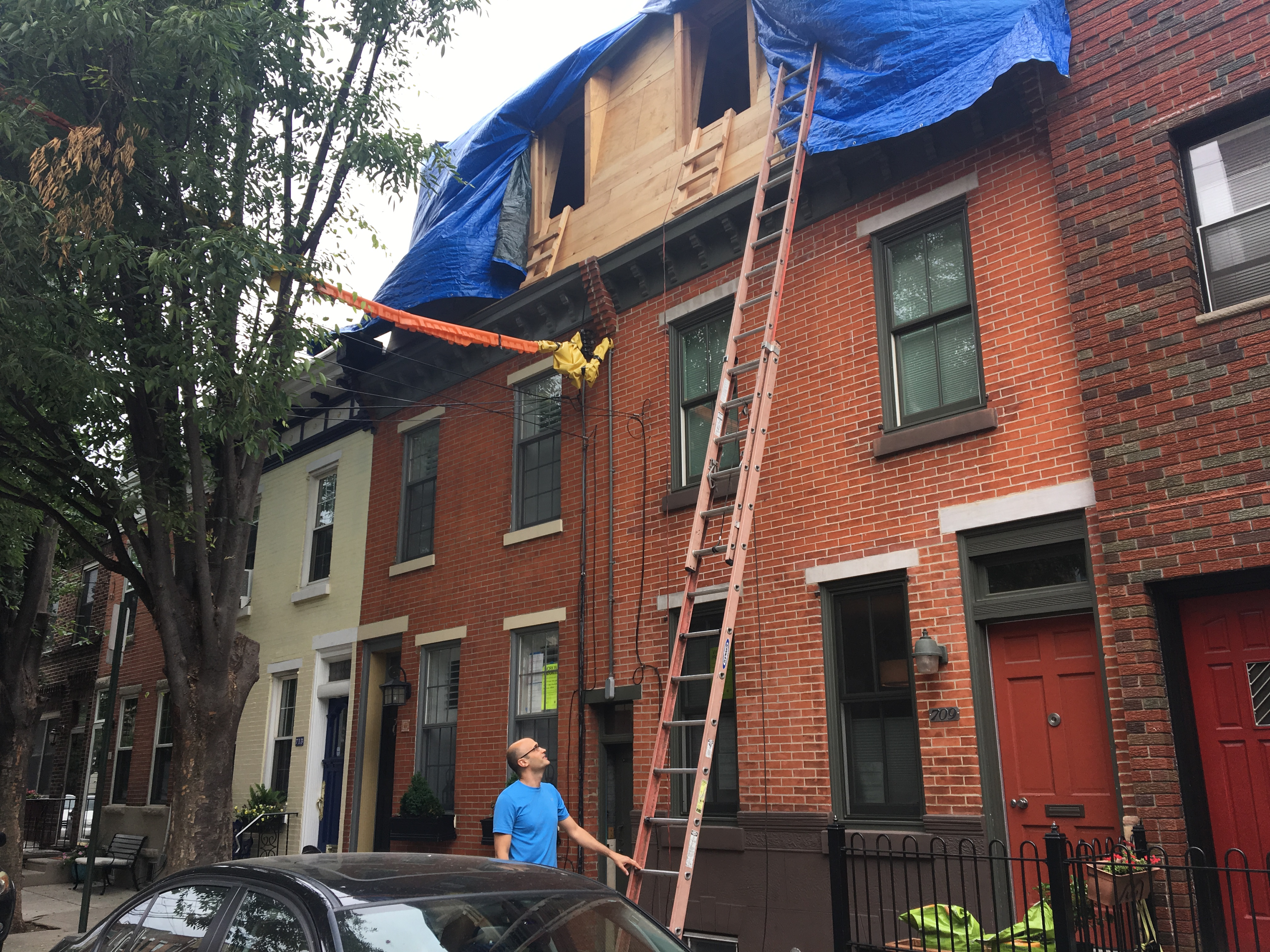 Laurent Hedquist inspects the third-floor addiiton he is putting on top of his Bella Vista home. He designed a twin version for his nextdoor neighbor.