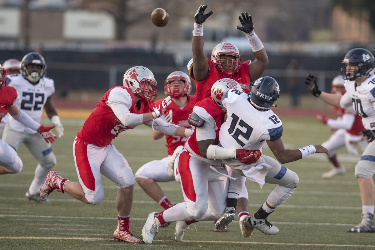 Wisdom Quarshie (arms up) and his St. Joseph teammates pressure Mater Dei quarterback George Pearson in the NonPublic Group 2 championship game at Rowan University back on Dec. 3.