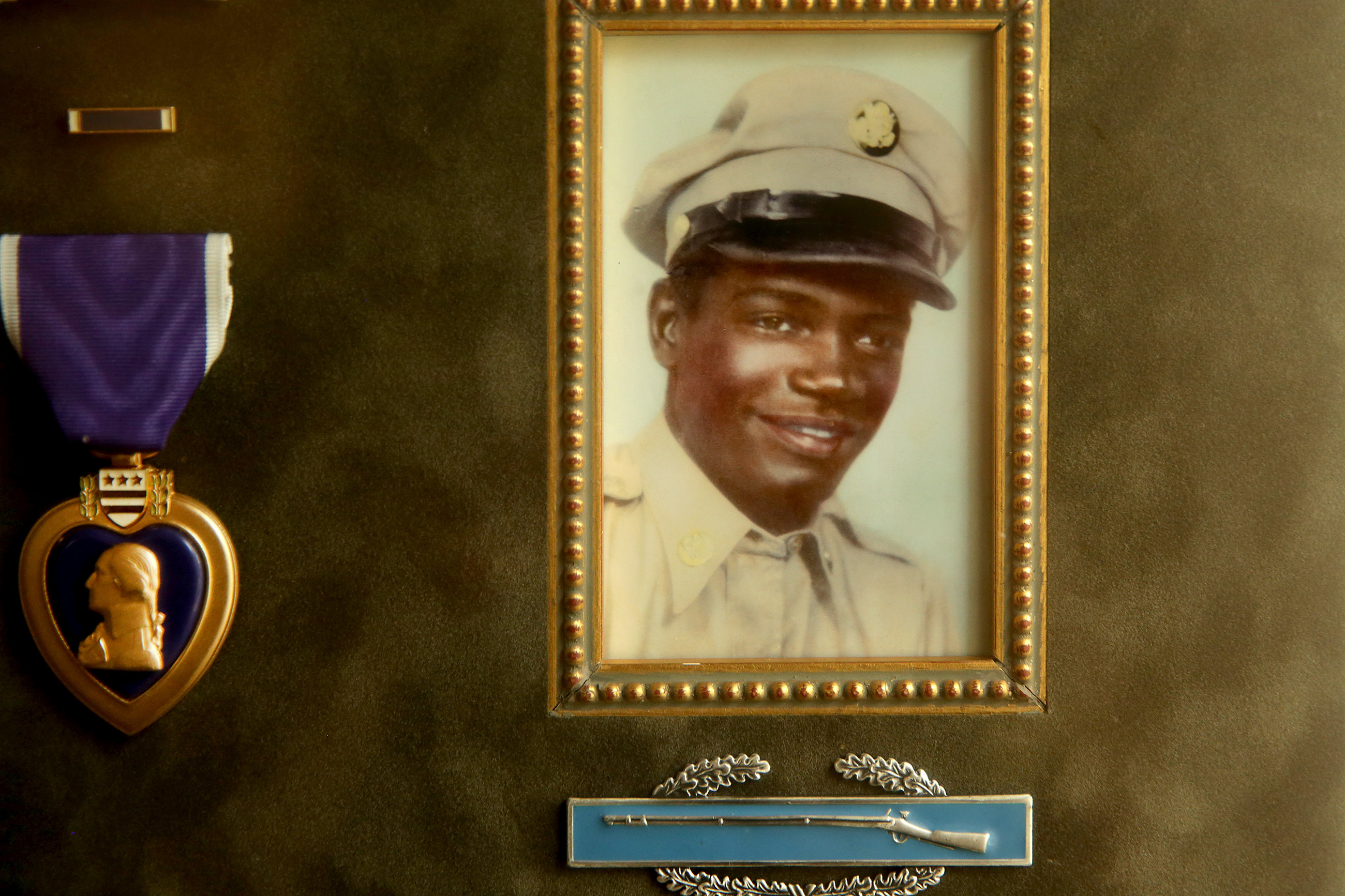 A photo of Cpl. Joseph Robinson and his Purple Heart medal is on display in his brother Wallace's home in Elkins Park, PA on June 18, 2018. Cpl. Joseph Robinson died a prisoner of war in North Korea in 1951.