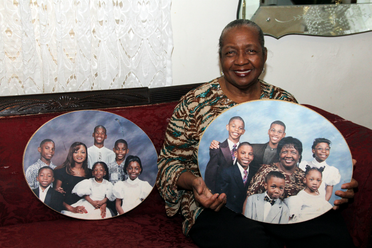 Sharonell Fulton, one of three foster parents with Catholic Social Services who testified this week, holds a photo of some of the children she has fostered. Fulton is also one of the plaintiffs in the lawsuit.