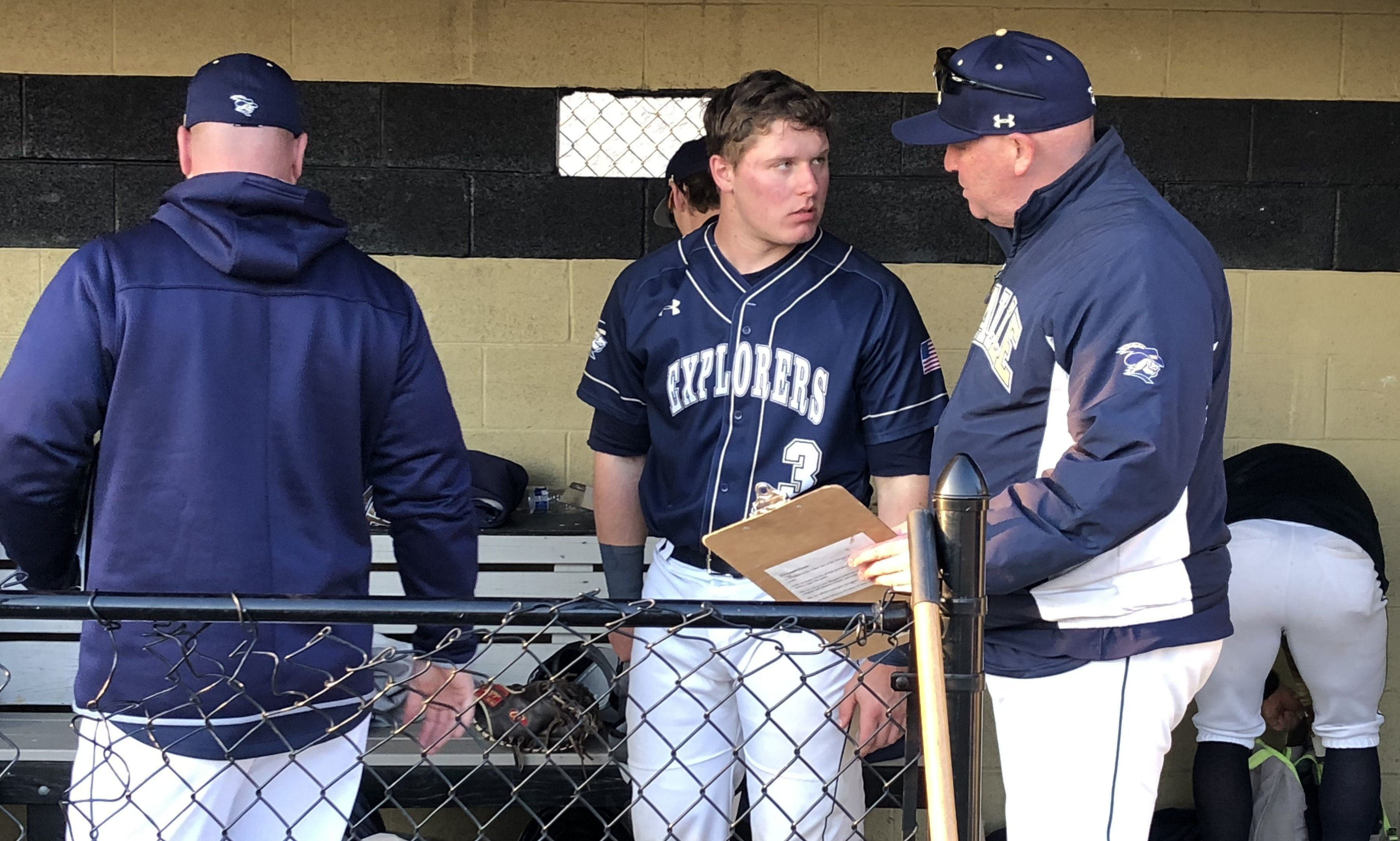 La Salle catcher Andrew Cossetti talks in the dugout with assistant coach Mike O´Connor. #submittedImage