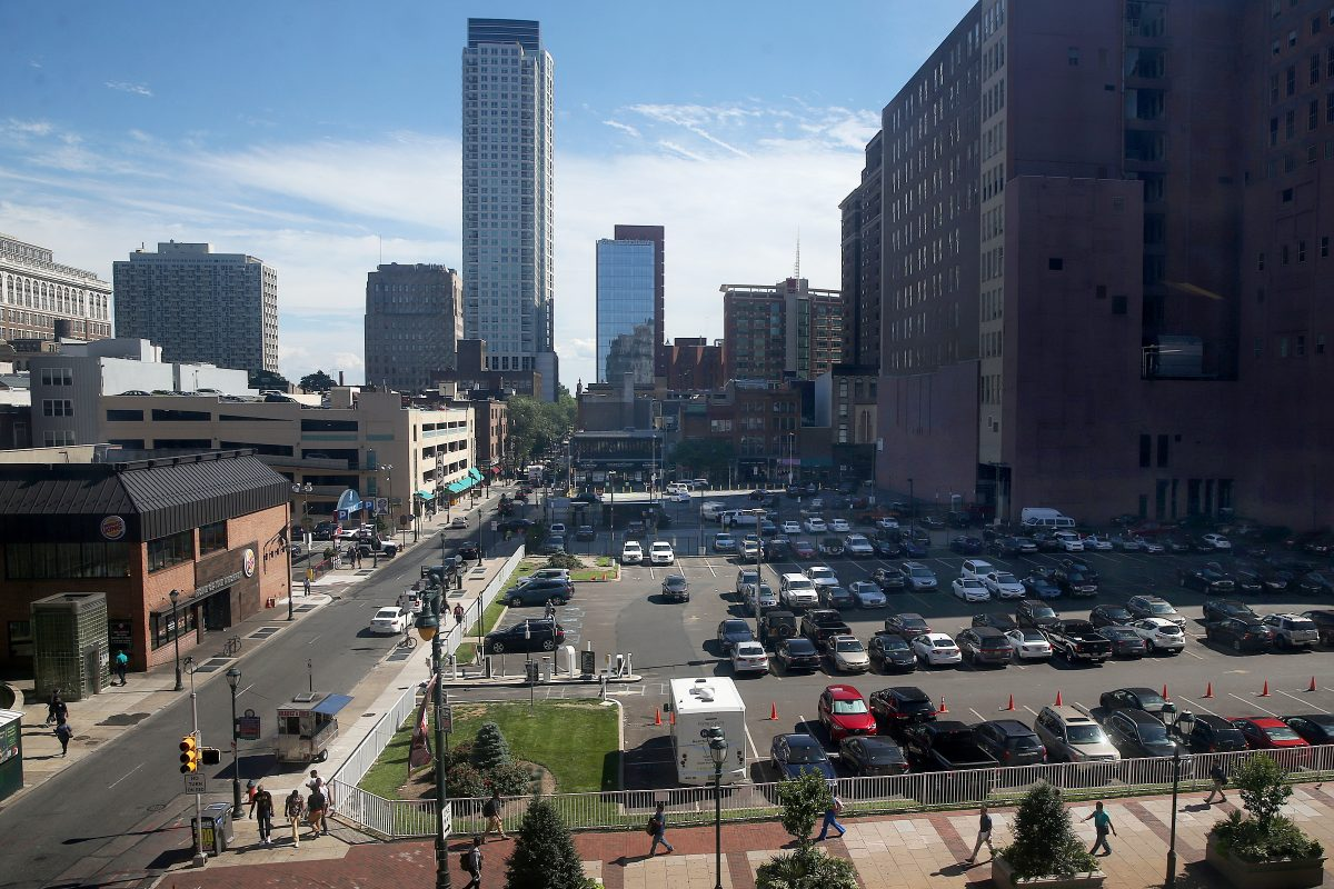 The parking lots at Eighth and Market streets (foreground) in Center City. A co-owner of the lot has a deal to buy the adjacent, Philadelphia Parking Authority-owned lot at Eighth and Chestnut streets (rear), and is talking about a hotel, offices and shopping there.