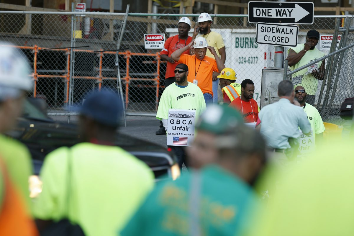 Union workers gather outside the construction site as union crane operators protest in front of the Comcast tower in Philadelphia, PA on Friday.