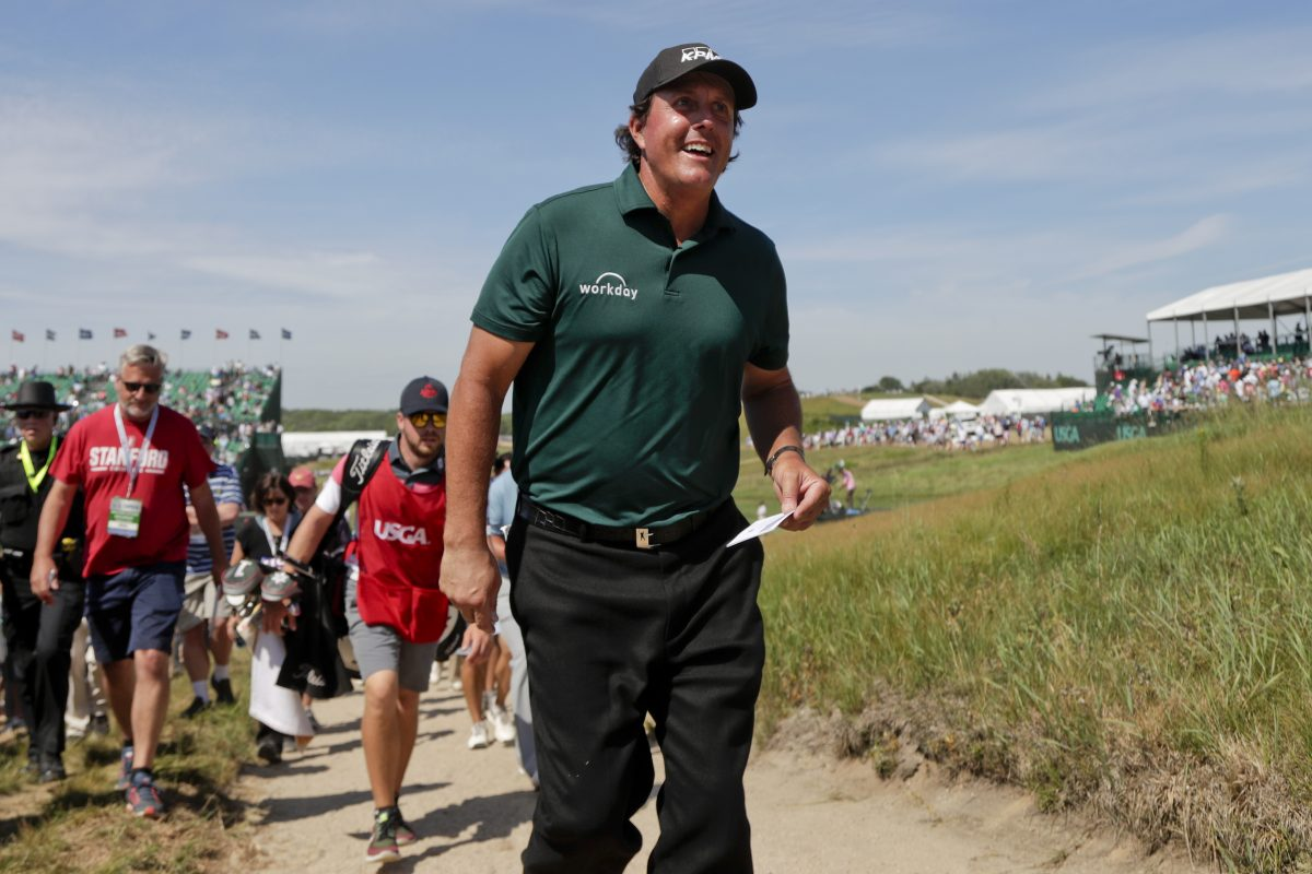 The U.S. Golf Association assessed Phil Mickelson a 2-stroke penalty for hitting a moving ball at the U.S. Open, but did not disqualify him.