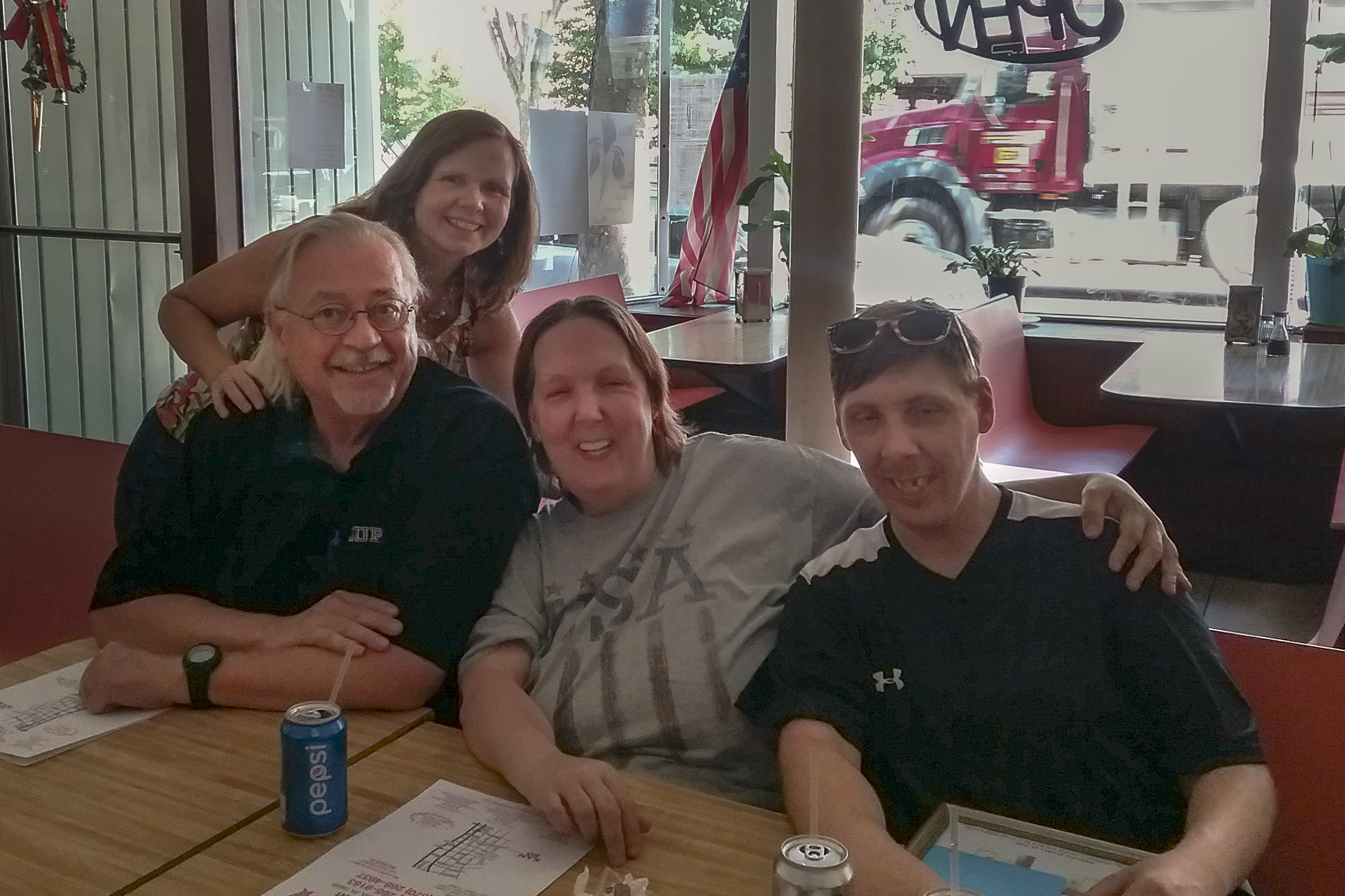 After a search that started in 2007, Jean Searle met her son, Robert Cummings, next to her on the right, for the first time on May 29, 2018, at a Chinese restaurant in Towanda, Pa. With Searle and Cummings are James W. Conroy (l) and Maura McInernery(standing), who helped with the search.