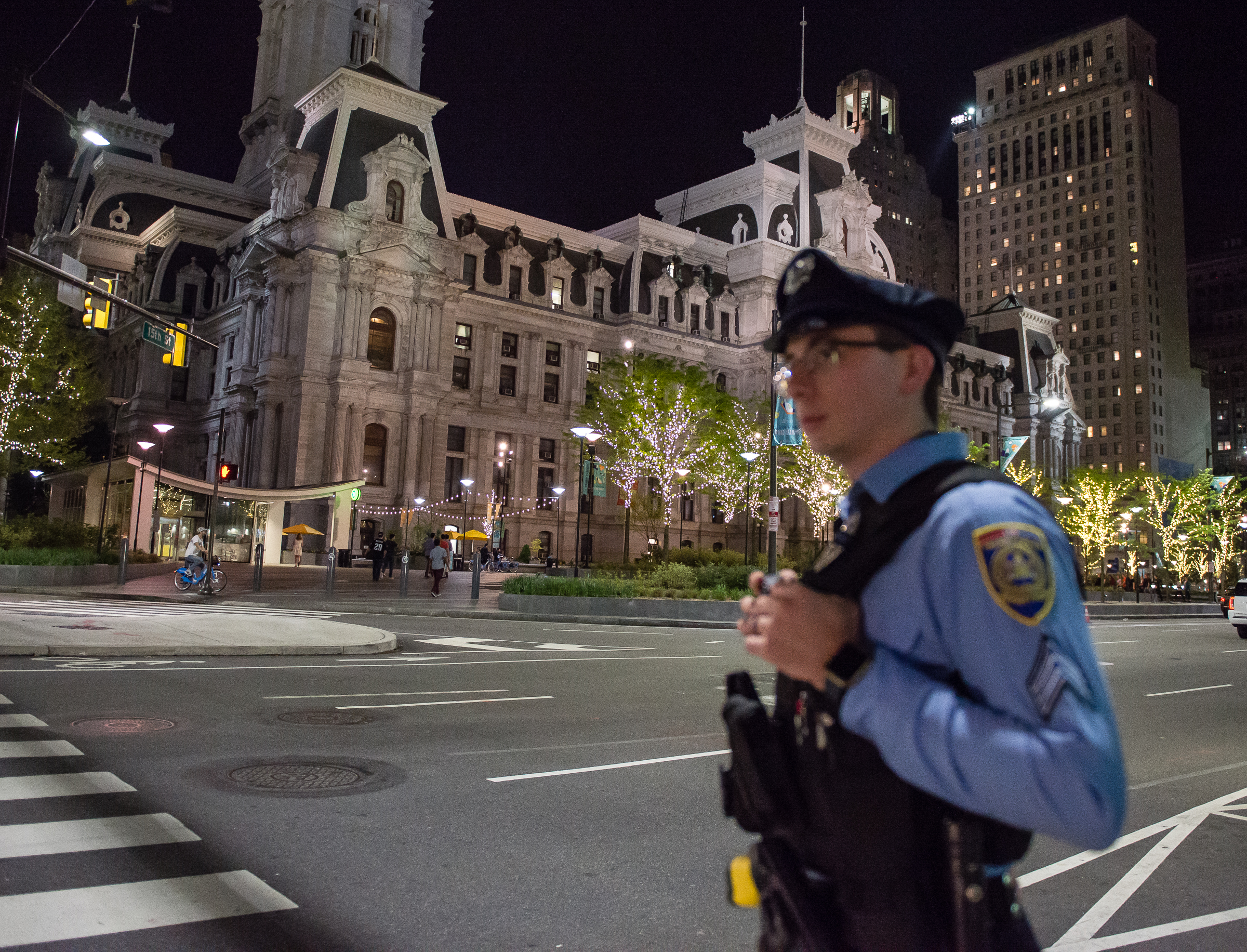 Sergeant Marc Pasquarella of the SEPTA Transit Police pauses in front of City Hall during his evening duties.